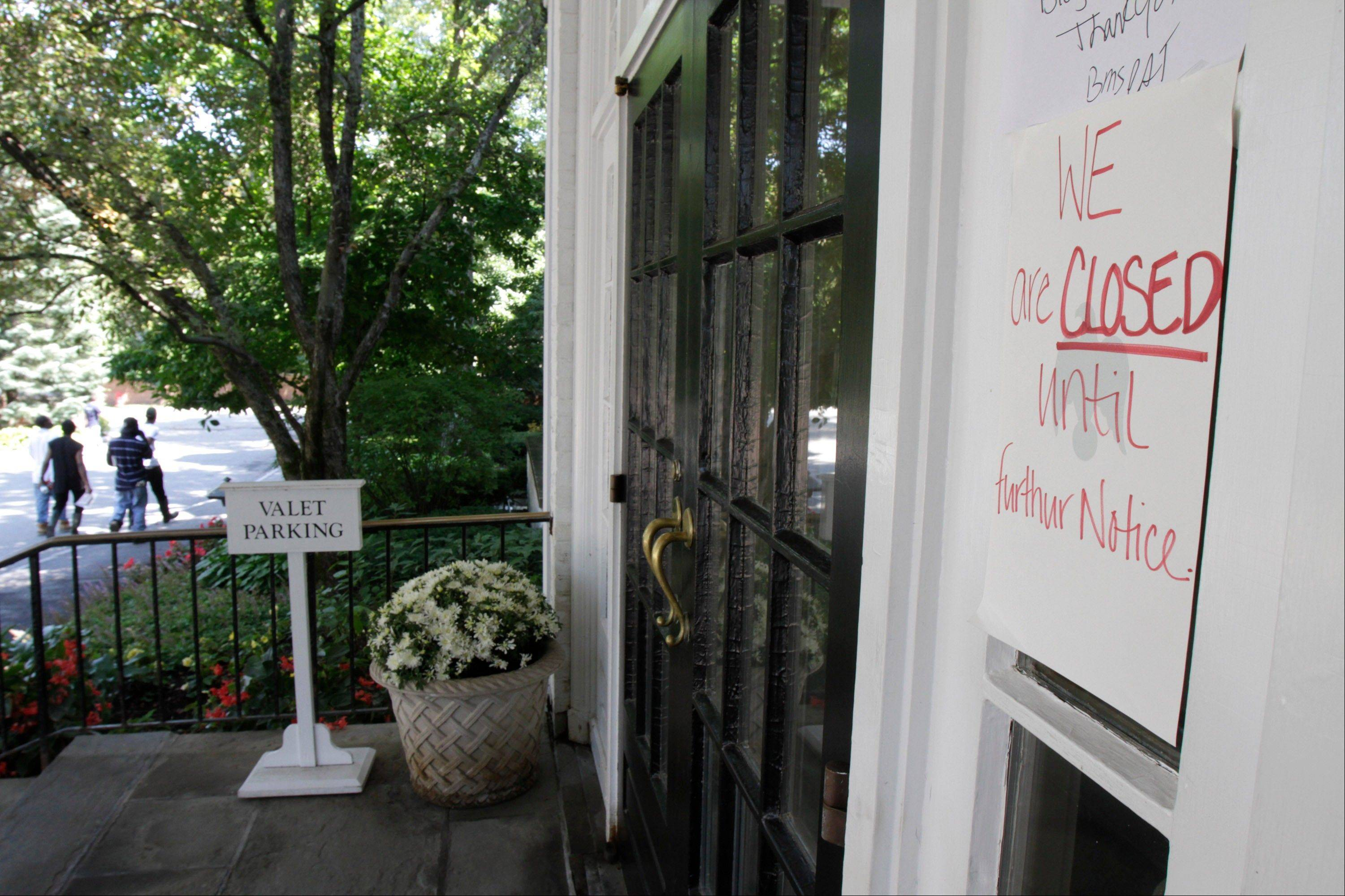 The Woodstock Inn displays a closed sign after suffering water damage from Hurricane Irene.