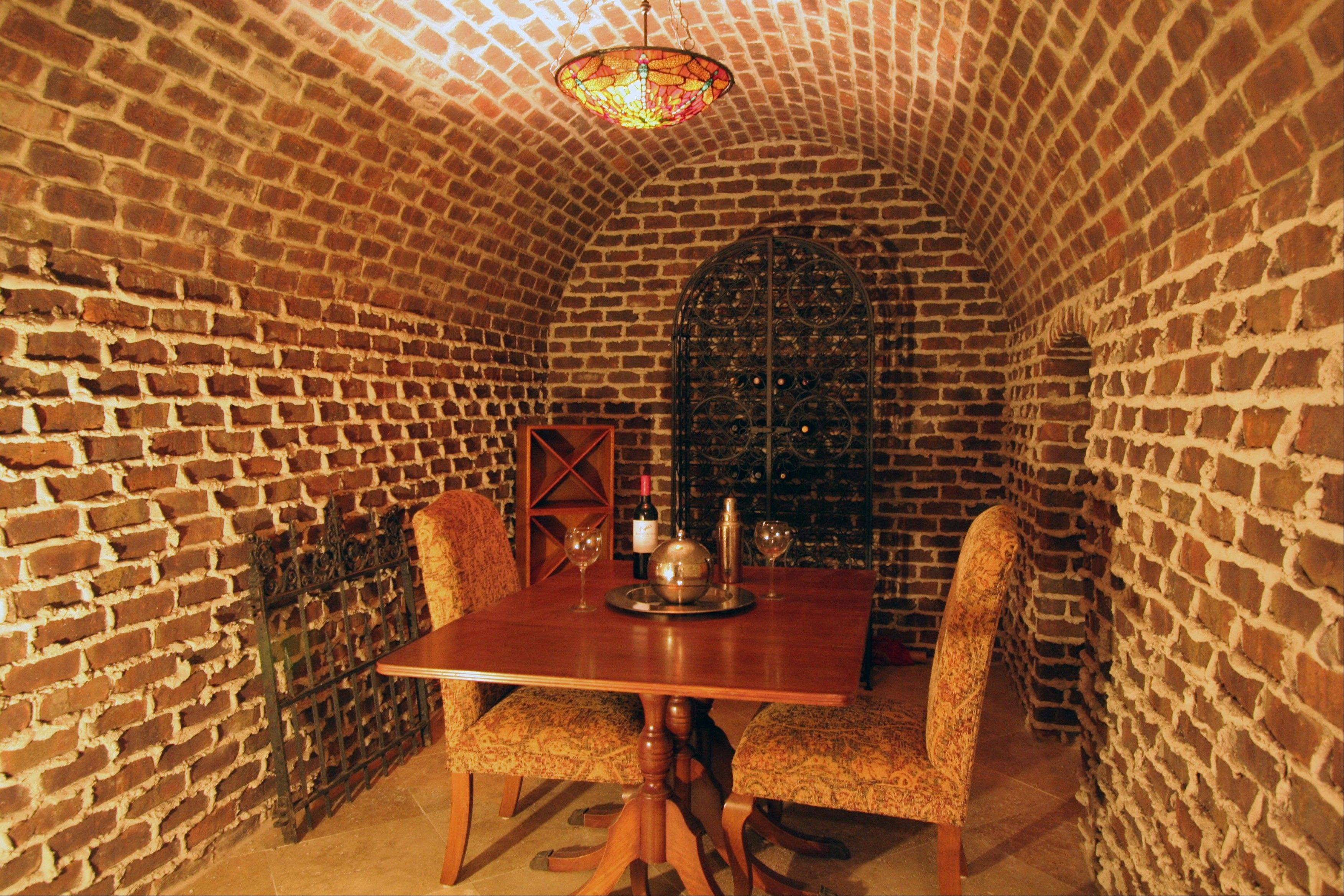 Pause for an after-dinner drink in the home�s wine cellar.