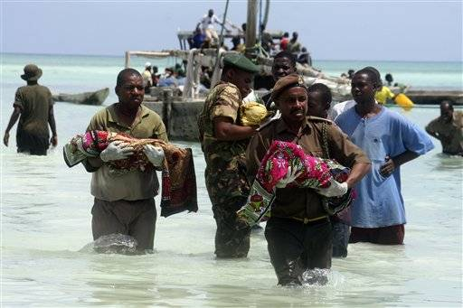 Tanzanian police carry bodies of children from the sea in Zanzibar, Tanzania, Sept 10. An overcrowded ship sank in deep sea off mainland Tanzania on Saturday with about 600 people onboard, and about 370 people are believed missing or dead. The ferry, M.V. Spice Islanders, was heavily overloaded and some potential passengers had refused to board when it was leaving the mainland port of Dar es Salaam, said survivor Abdullah Saied. It sank in an area with heavy currents in deep sea between mainland Tanzania and Pemba Island at about 1 a.m. Saturday. About 230 people had been rescued and 40 bodies had been recovered, said Mohamed Aboud, the minister for the vice president's office.