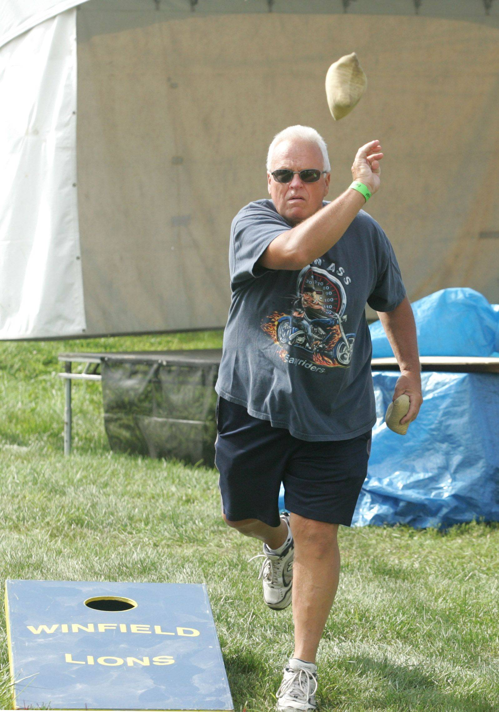 Chuck Hahn of Winfield participates in the fifth annual cornhole tournament Saturday at Winfield�s Good Old Days festival.