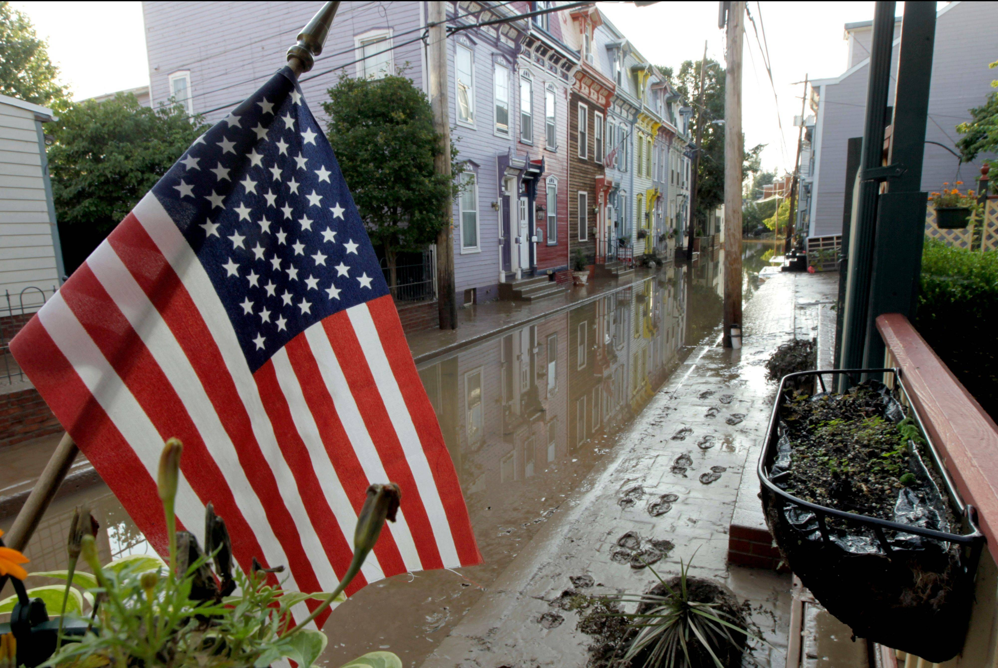 An American flag still flies in the Shipoke area in Harrisburg, Pa., Saturday after flooding caused by the remnants of Tropical Storm Lee