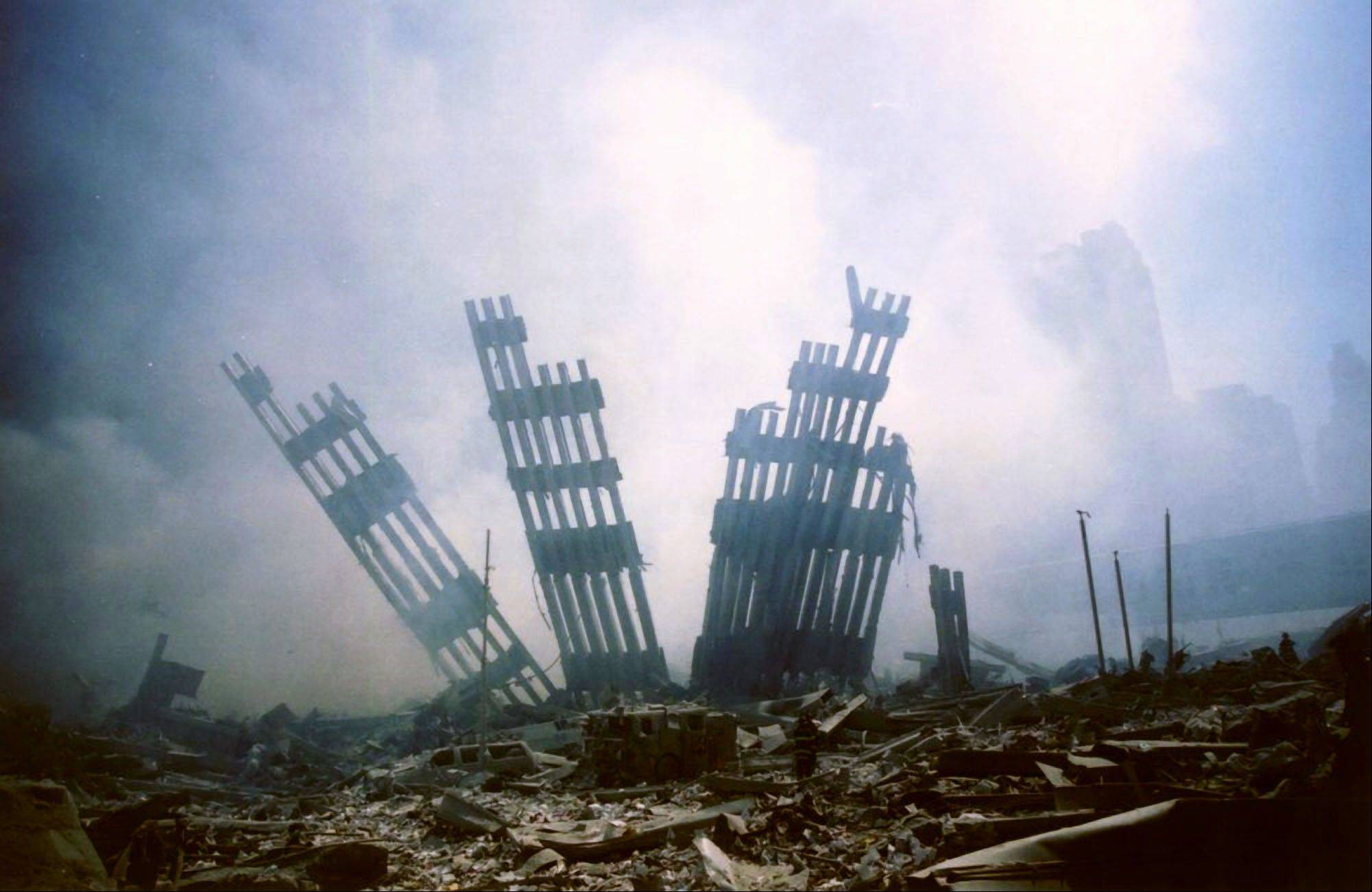 In this Sept. 11, 2001 file photo, the remains of the World Trade Center stands amid the debris following the terrorist attack on the building in New York.