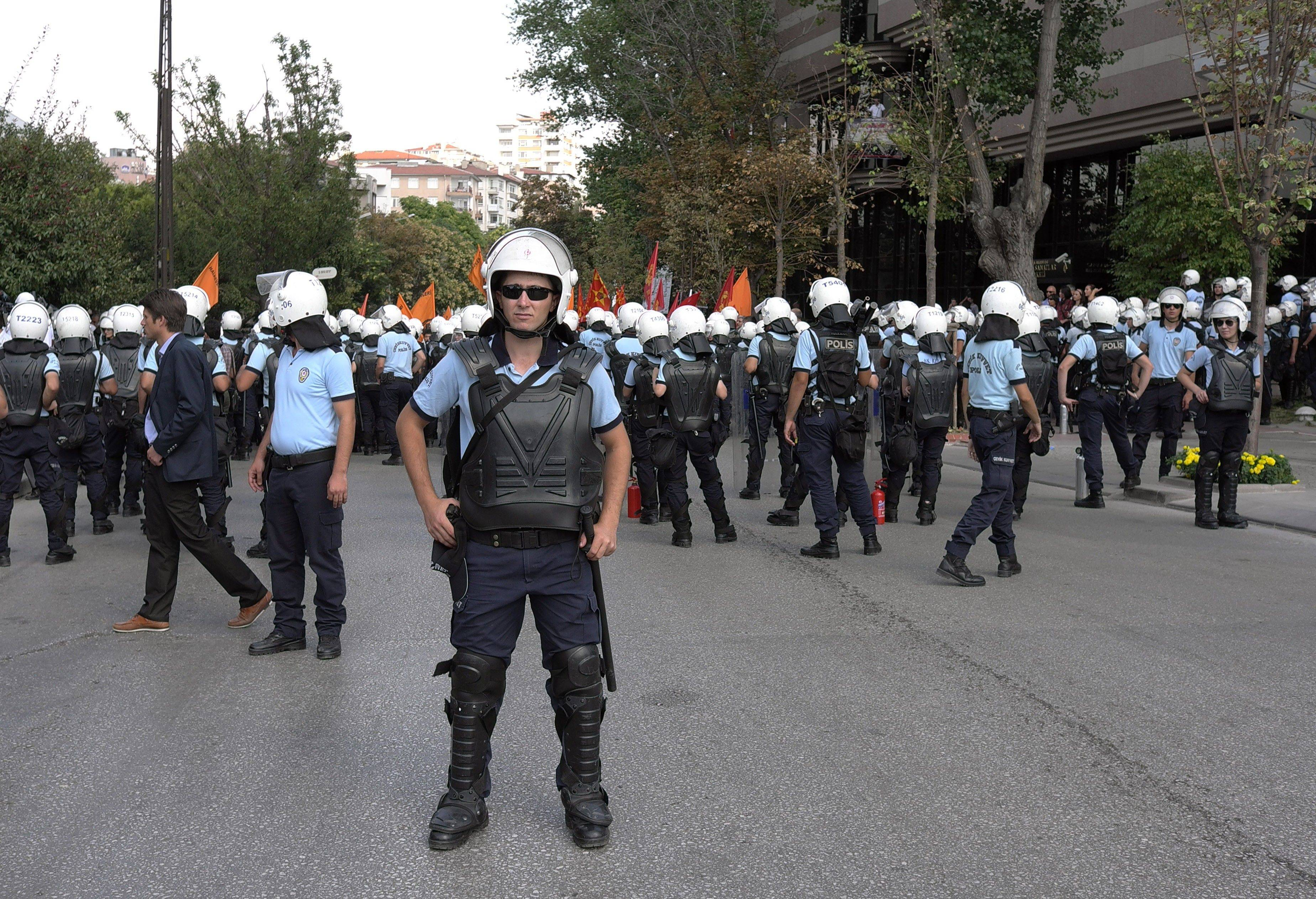 Riot police stand guard as leftist Turks protest Saturday against Turkey's Sept. 12, 1980 coup and chant anti-U.S. slogans outside the U. S. embassy in Ankara, Turkey.