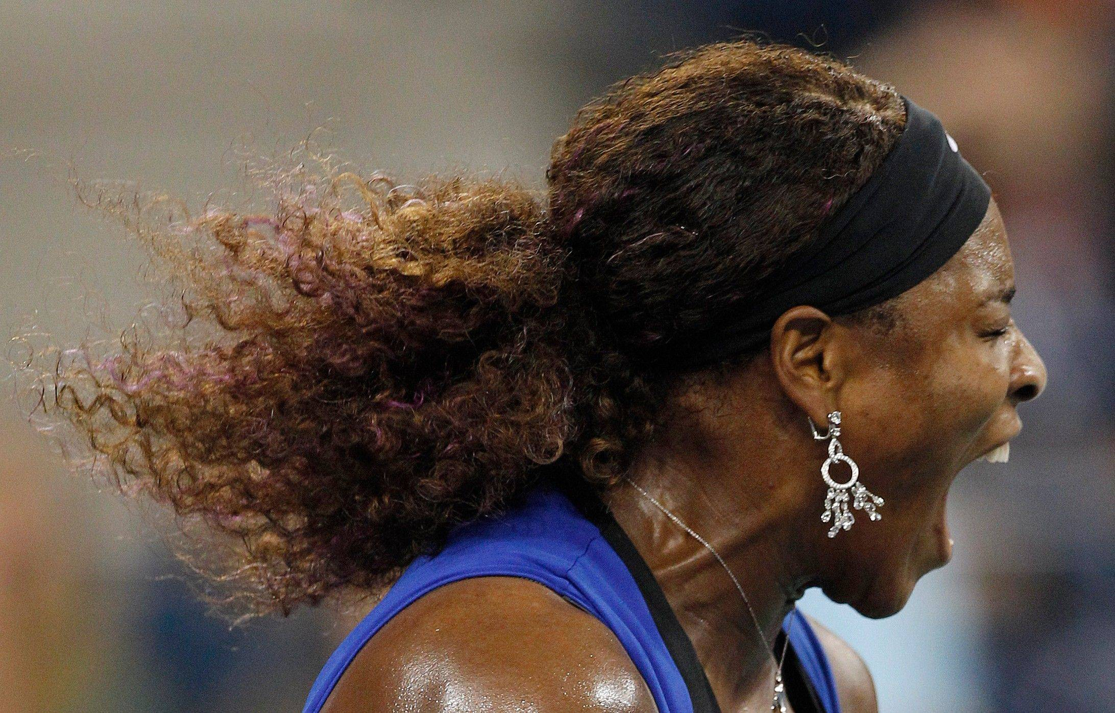 Serena Williams reacts Saturday during her semifinal match against Caroline Wozniacki at the U.S. Open.