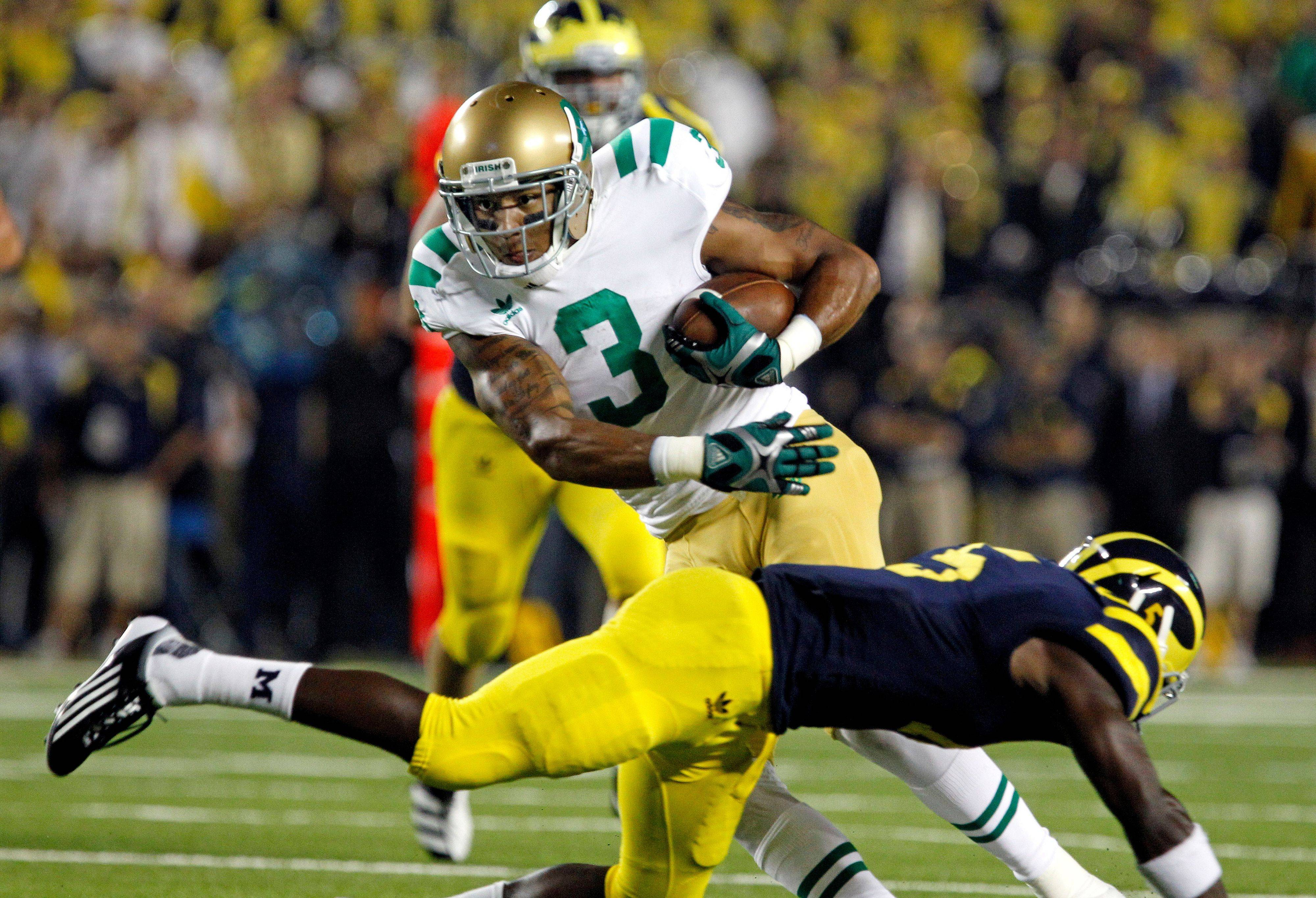 Notre Dame wide receiver Michael Floyd avoids a tackle from Michigan cornerback Courtney Avery in the second quarter Saturday night.