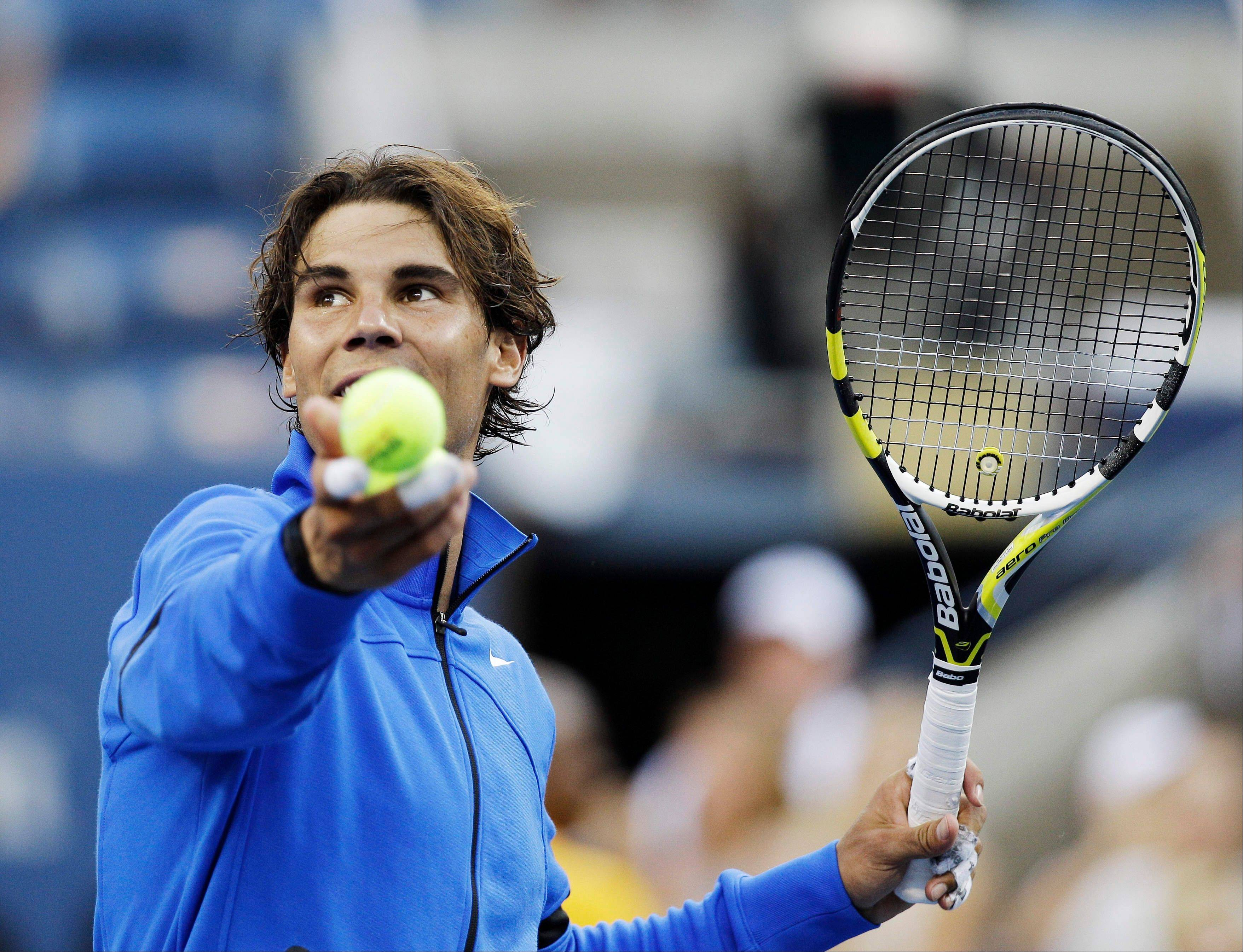 Rafael Nadal of Spain hits a ball into the stands after winning a quarterfinal match against Andy Roddick at the U.S. Open tennis tournament in New York, Friday, Sept. 9, 2011. (AP Photo/Matt Slocum)