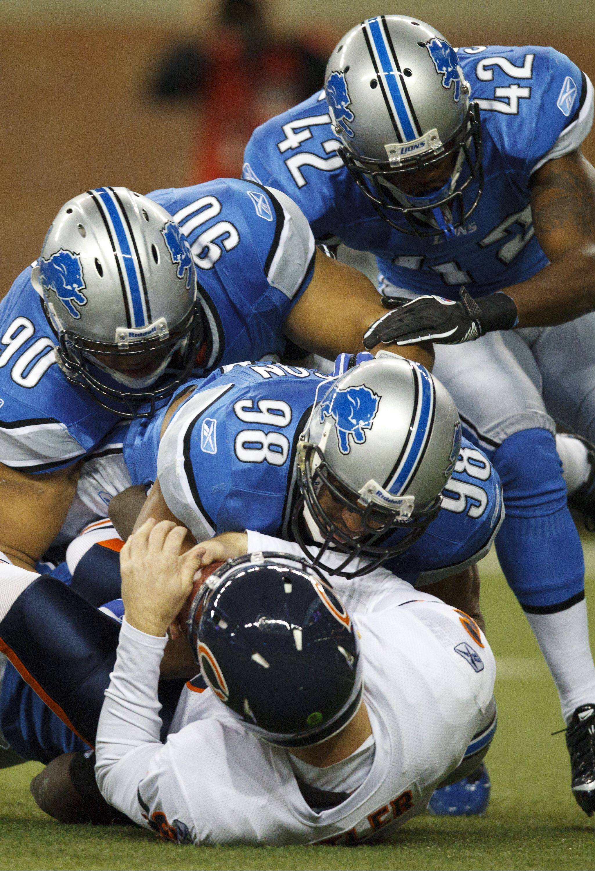 Detroit Lions defensive tackle Ndamukong Suh (90) and linebacker Julian Peterson (98) can make things difficult for quarterbacks, as Bears QB Jay Cutler found out last December.