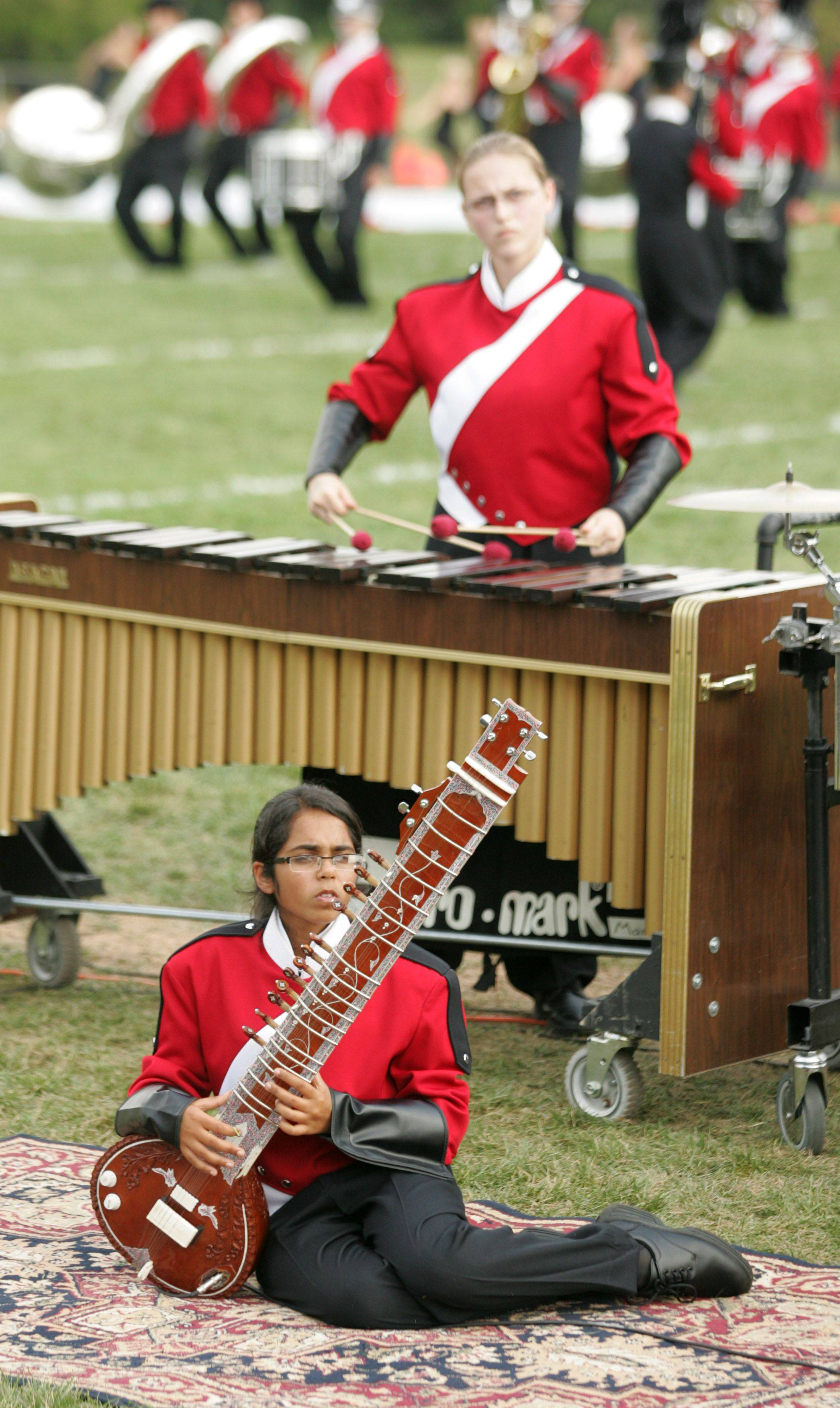 Naperville Central High School's Niti Prasad plays the sitar Saturday during the 33rd annual Lancer Joust Marching Band Competition at the Lake Park High School West campus.
