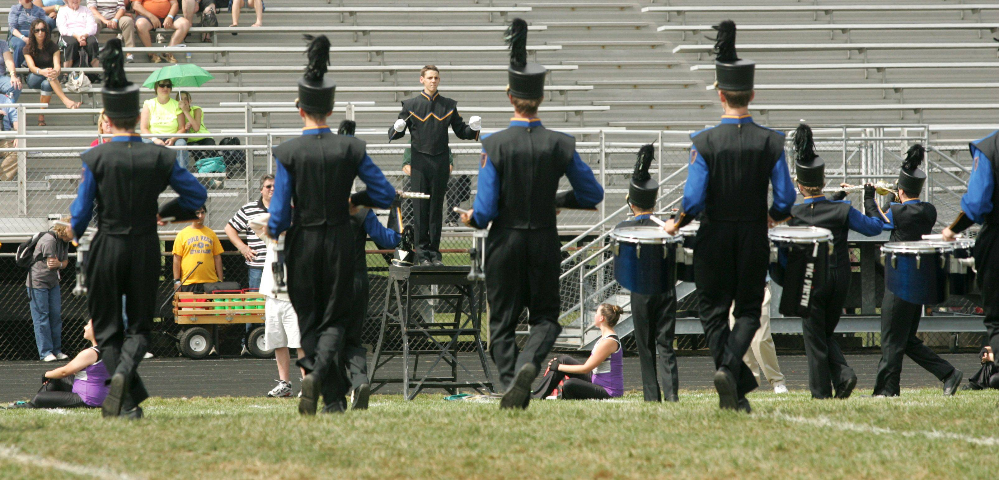 Wheaton North High School drum major Cole Manschot leads part of his squad Saturday during the 33rd annual Lancer Joust Marching Band Competition at the Lake Park High School West campus.