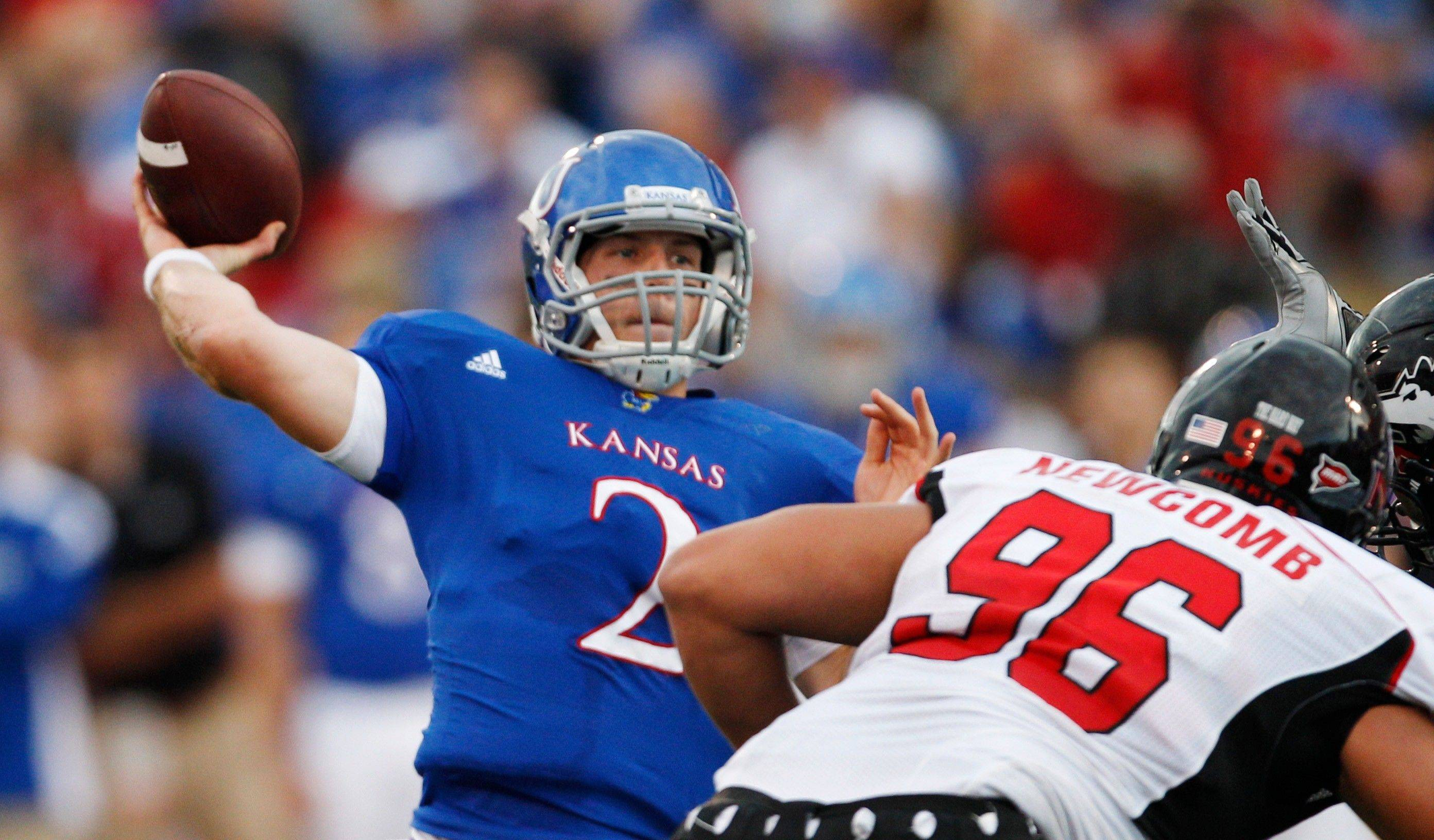 Kansas quarterback Jordan Webb throws a touchdown pass to tailback James Sims during the first half Saturday night.