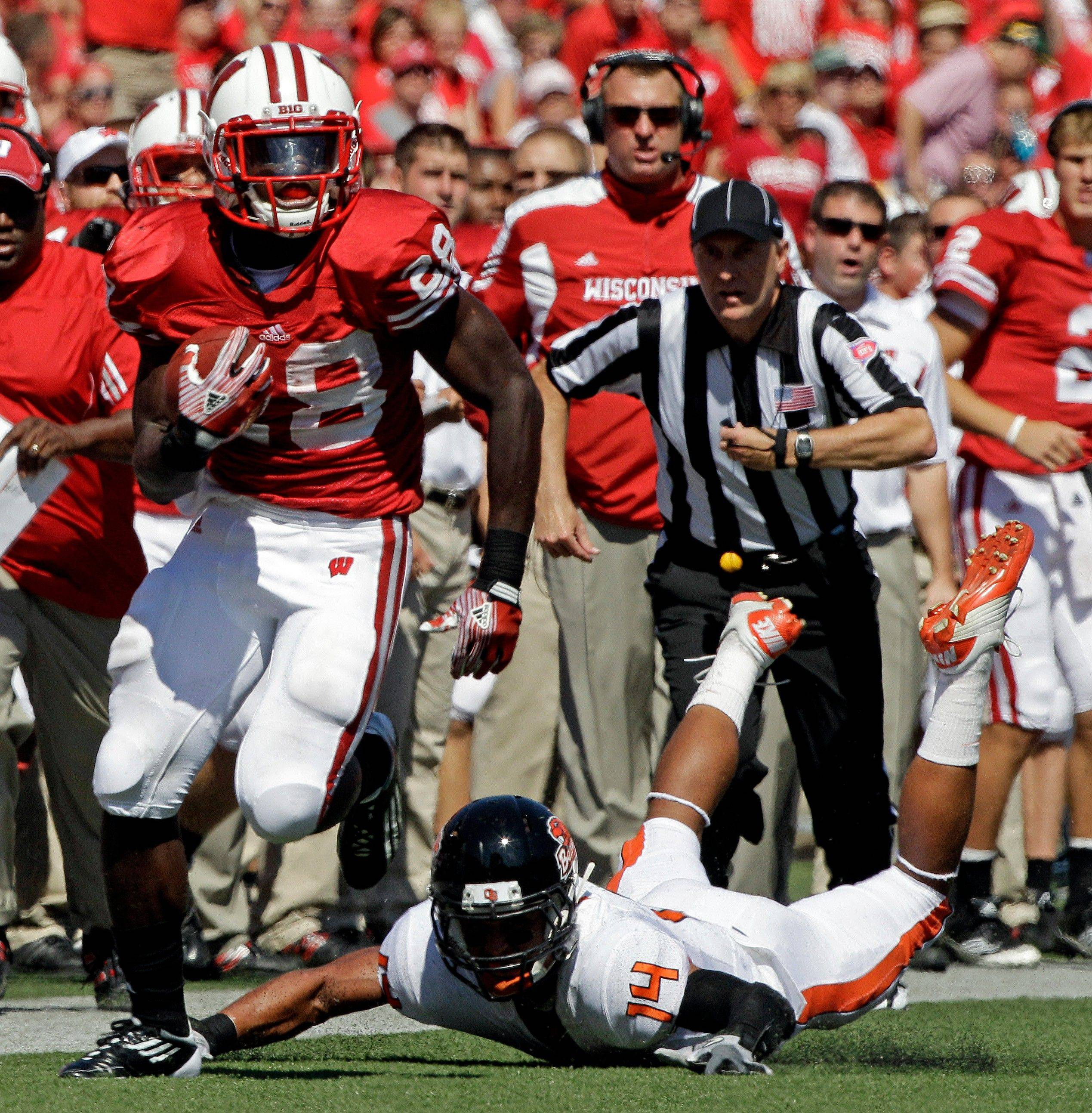 Wisconsin's Montee Ball runs past Oregon State's Jordan Poyer during the first half Saturday in Madison. Wisconsin beat Oregon State 35-0.
