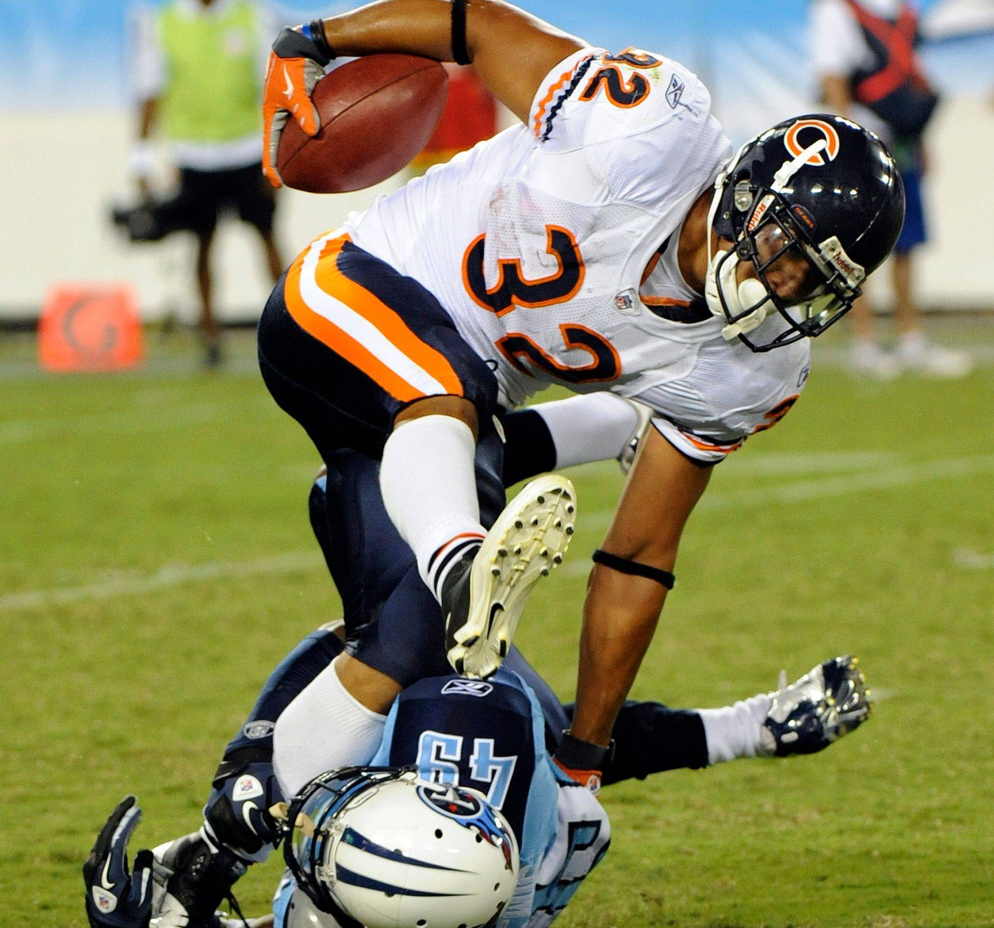 Bears running back Kahlil Bell is tripped up by Tennessee Titans cornerback LeQuan Lewis in a preseason game. Bell averaged 4.5 yards per carry in the preseason.