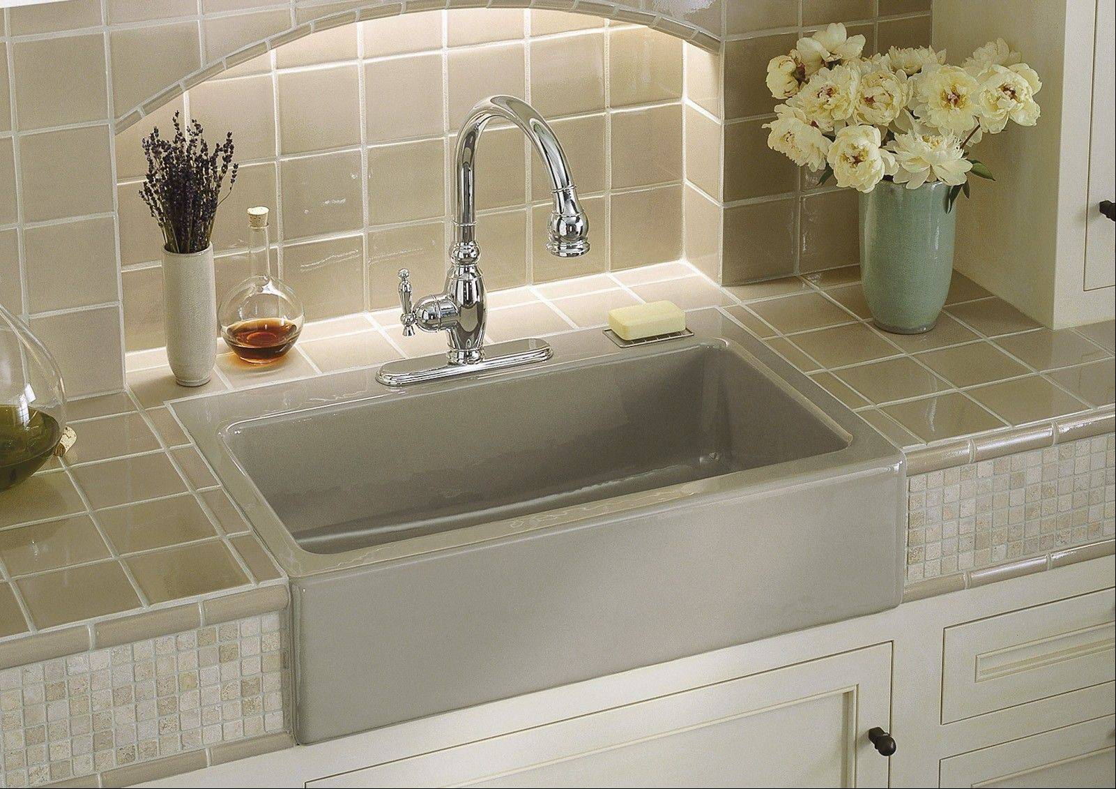 The farmhouse sink has become the darling of many contemporary kitchens.