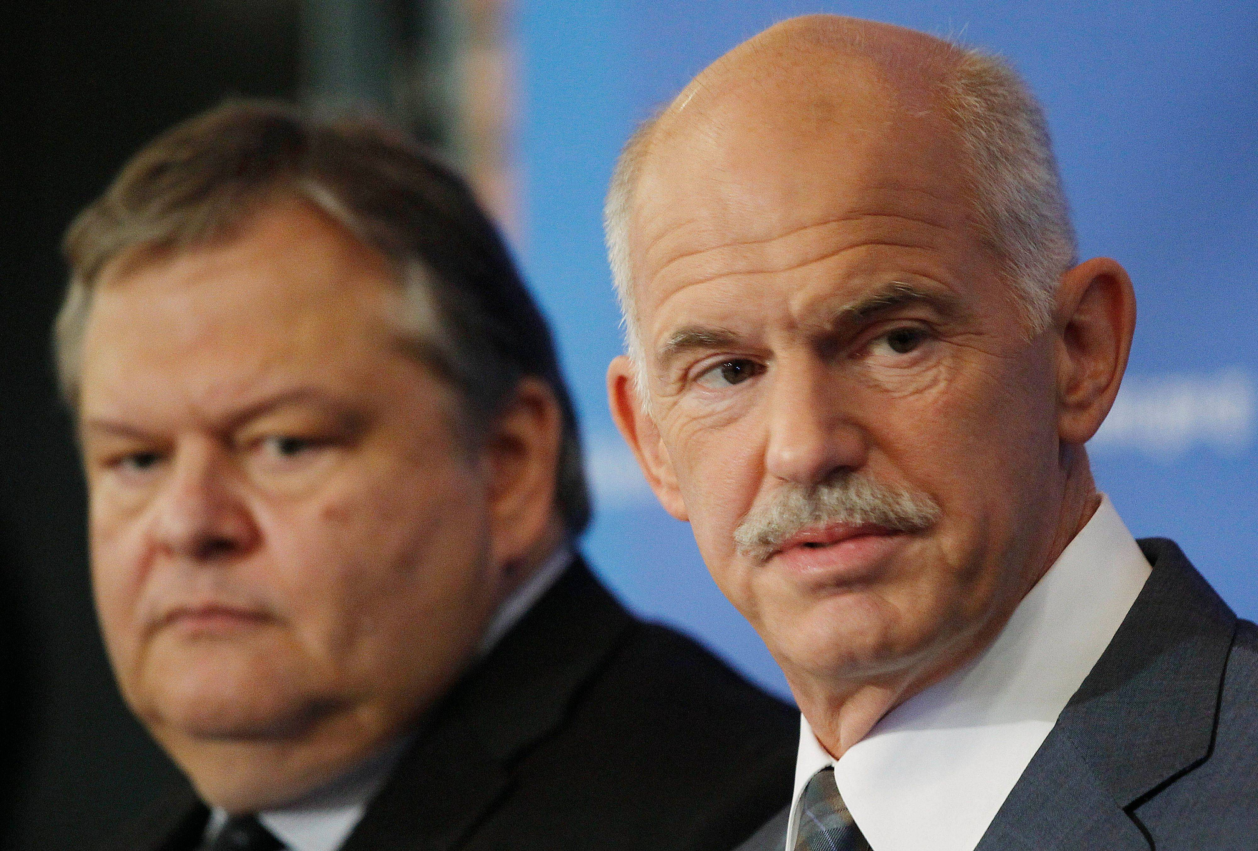 Greek Prime Minister George Papandreou, right, backed by his Finance Minister Evangelos Venizelos talks to the media during a press conference in Thessaloniki, Greece, Sunday.