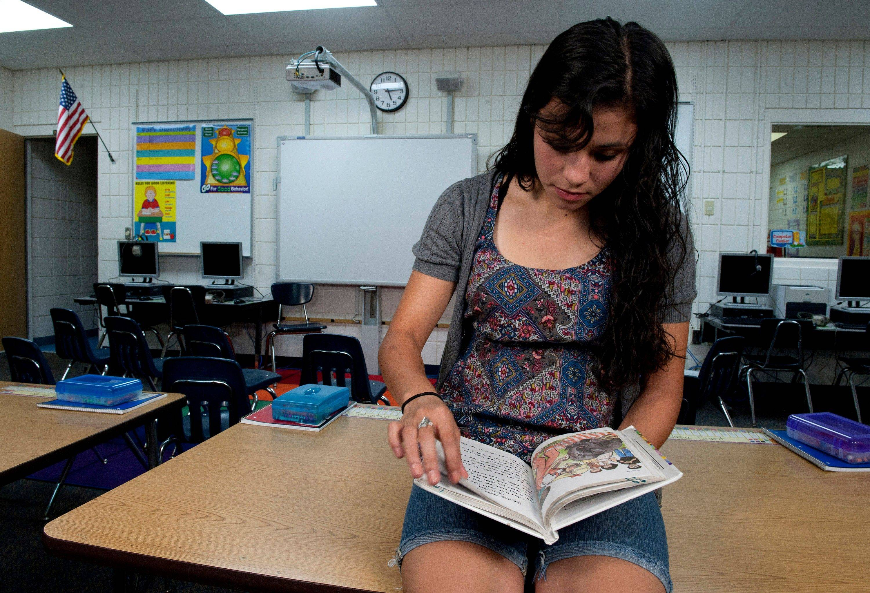 Chantal Guerrero, 17, sits in the same classroom at Emma E. Booker Elementary school where she sat on the morning of Sept. 11, 2001, with President George W. Bush. The President was listening to Guerrero and her second-grade classmates read aloud, from the same book Guerrero is thumbing though, when then White House Chief of Staff Andrew Card whispered into Bush's ear that a second plane had hit the World Trade Center in New York City.
