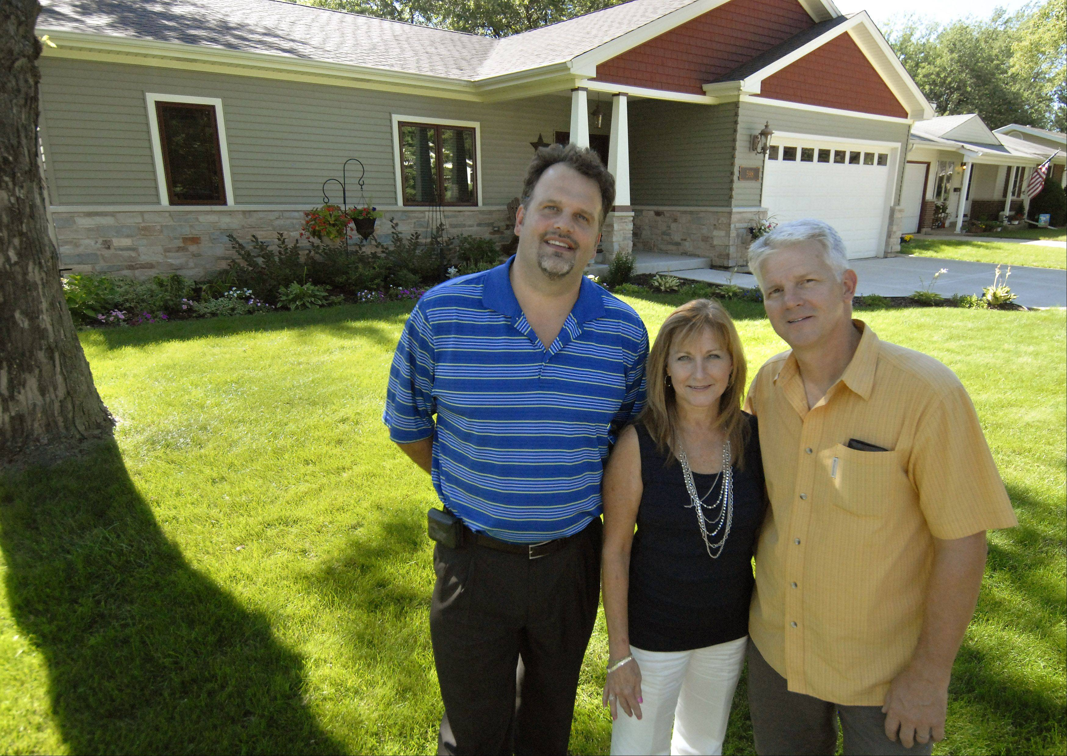 Tony Slade of DESIGNfirst, left, worked with Maureen and Jim Lenski to incorporate their wishes in the remodel of their Elk Grove Village home.