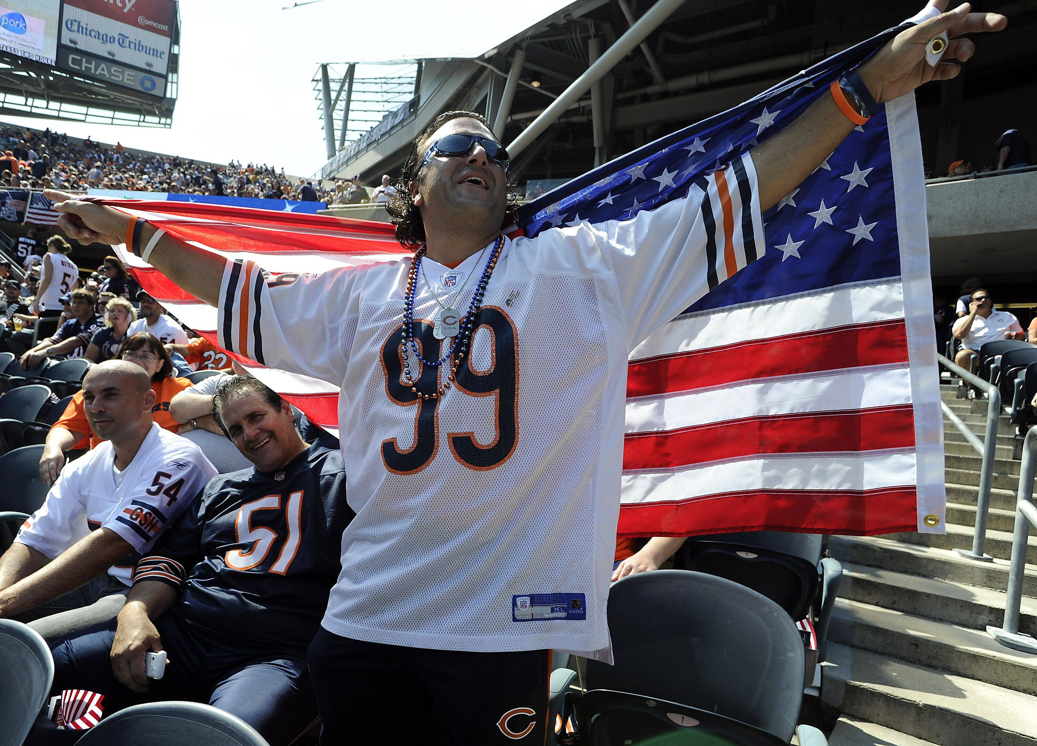Bears' fan Tony Capuani of Elgin honors the victims of 911 with the American flag before the game.