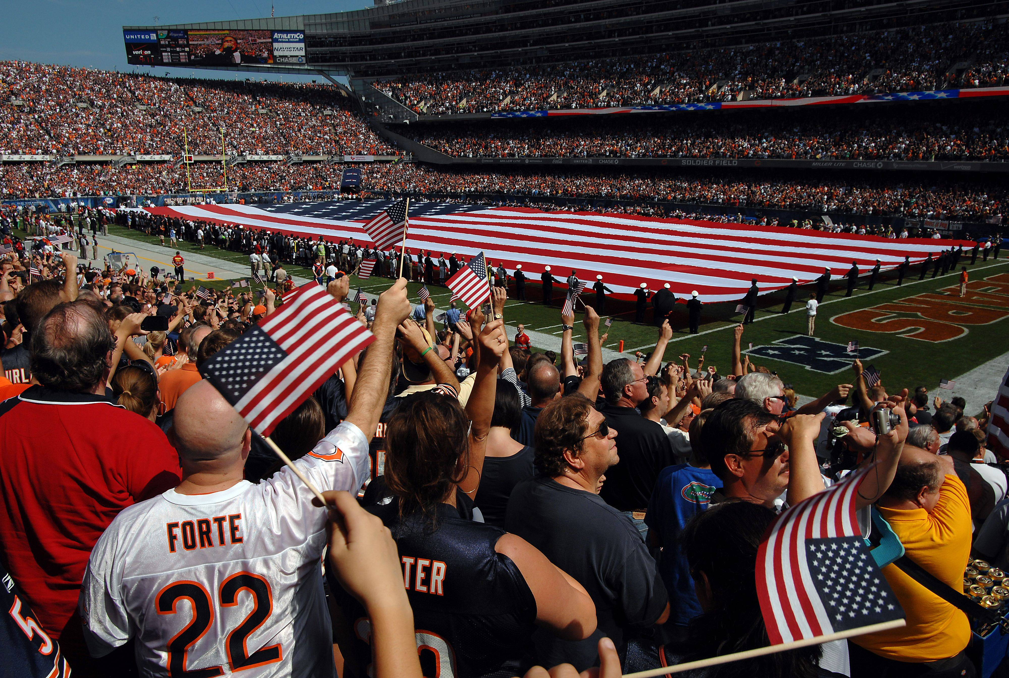 Bears fans show their patriotic spirit before Sunday's victory at Soldier Field by waving flags and cheering. A moment of silence was also held for the victims of the 9/11 attacks.