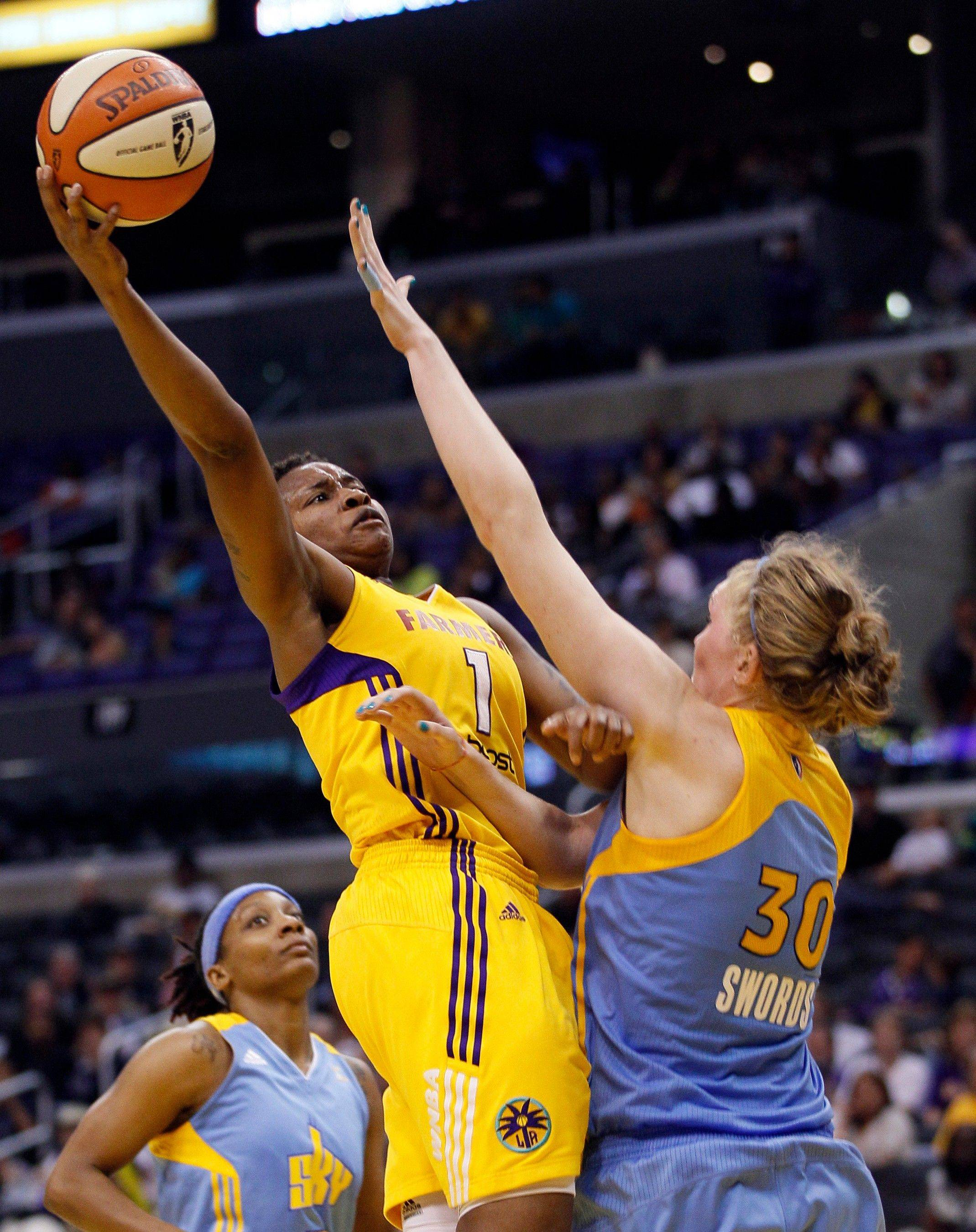 Los Angeles Sparks guard Natasha Lacy (1) goes up for a basket over Chicago Sky center Carolyn Swords (30) during the second half Saturday night. The Sparks won 74-67.