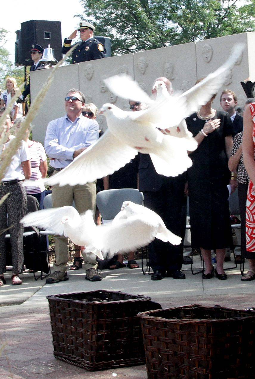 Doves are released during a 9/11 10th anniversary ceremony Sunday at the Commander Dan Shanower Memorial in Naperville.