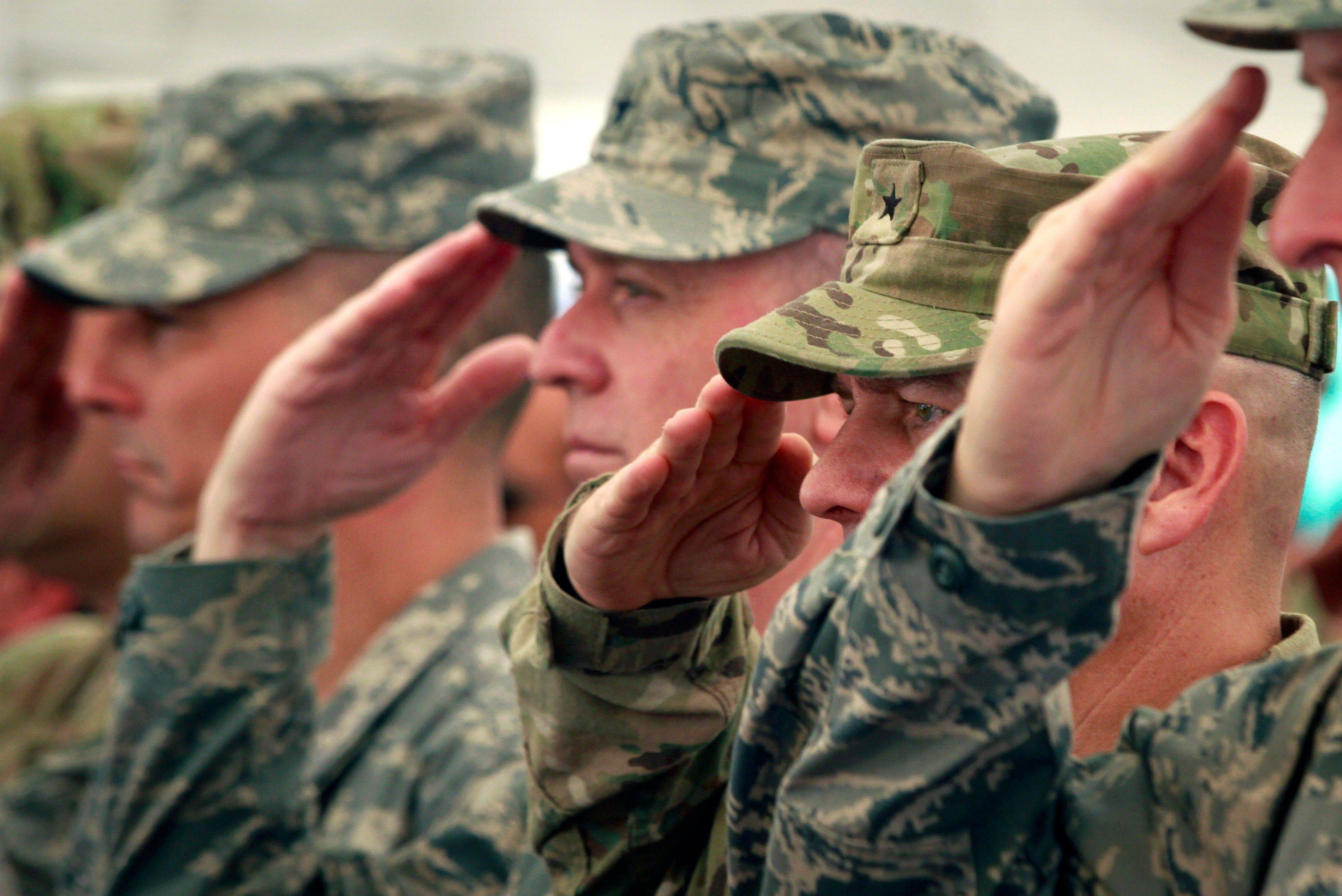 U.S. soldiers with the NATO-led International Security Assistance Force (ISAF) salute during an event to mark the 10th anniversary of the Sept. 11 attacks on the United States, at the U.S. embassy in Kabul, Afghanistan Sunday, Sept. 11, 2011.