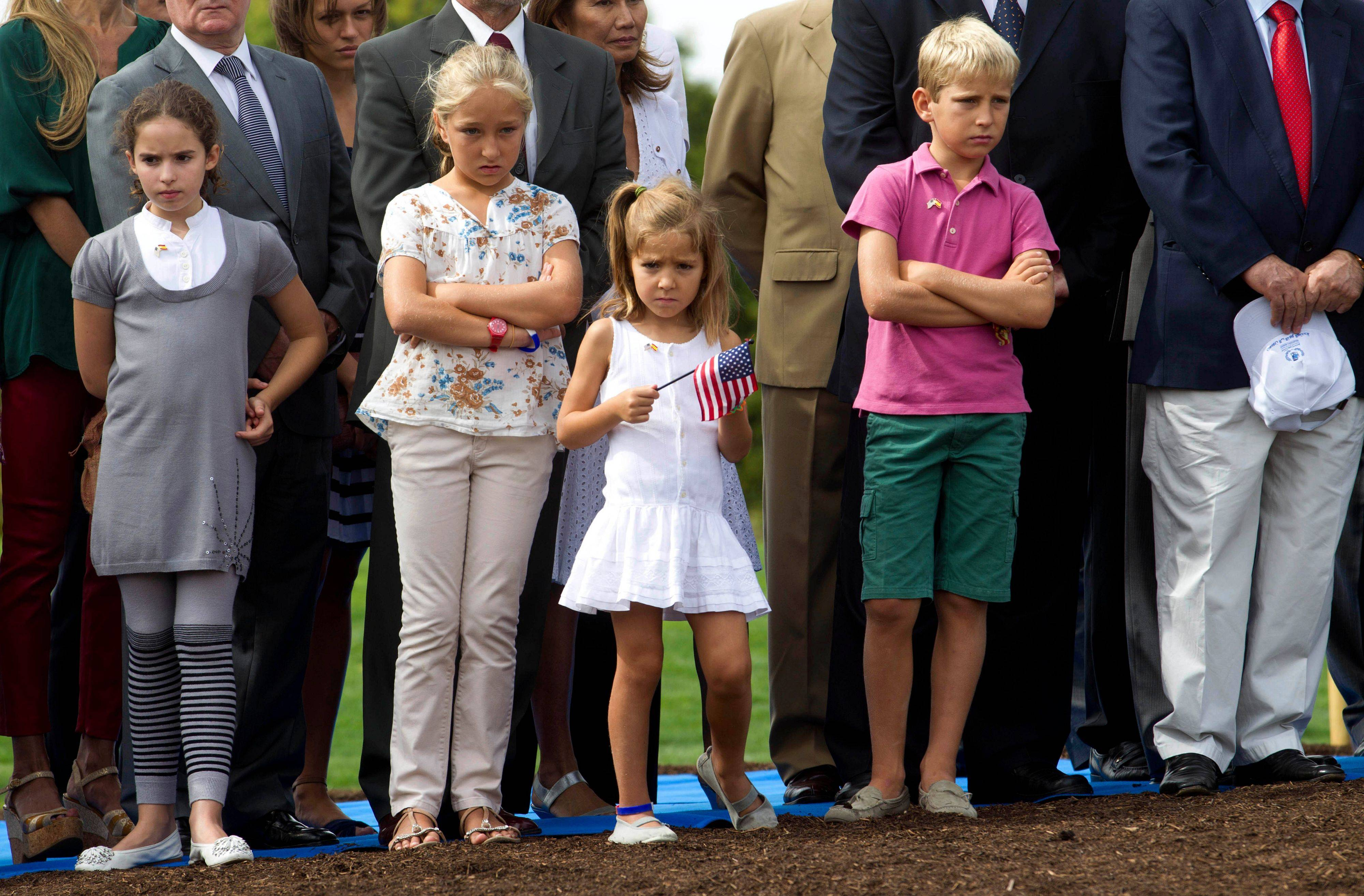 Children stand during a commemorative ceremony in Madrid Sunday Sept. 11, 2011 to mark the tenth anniversary of the terrorist attacks in New York, Washington D.C. and Pennsylvania.