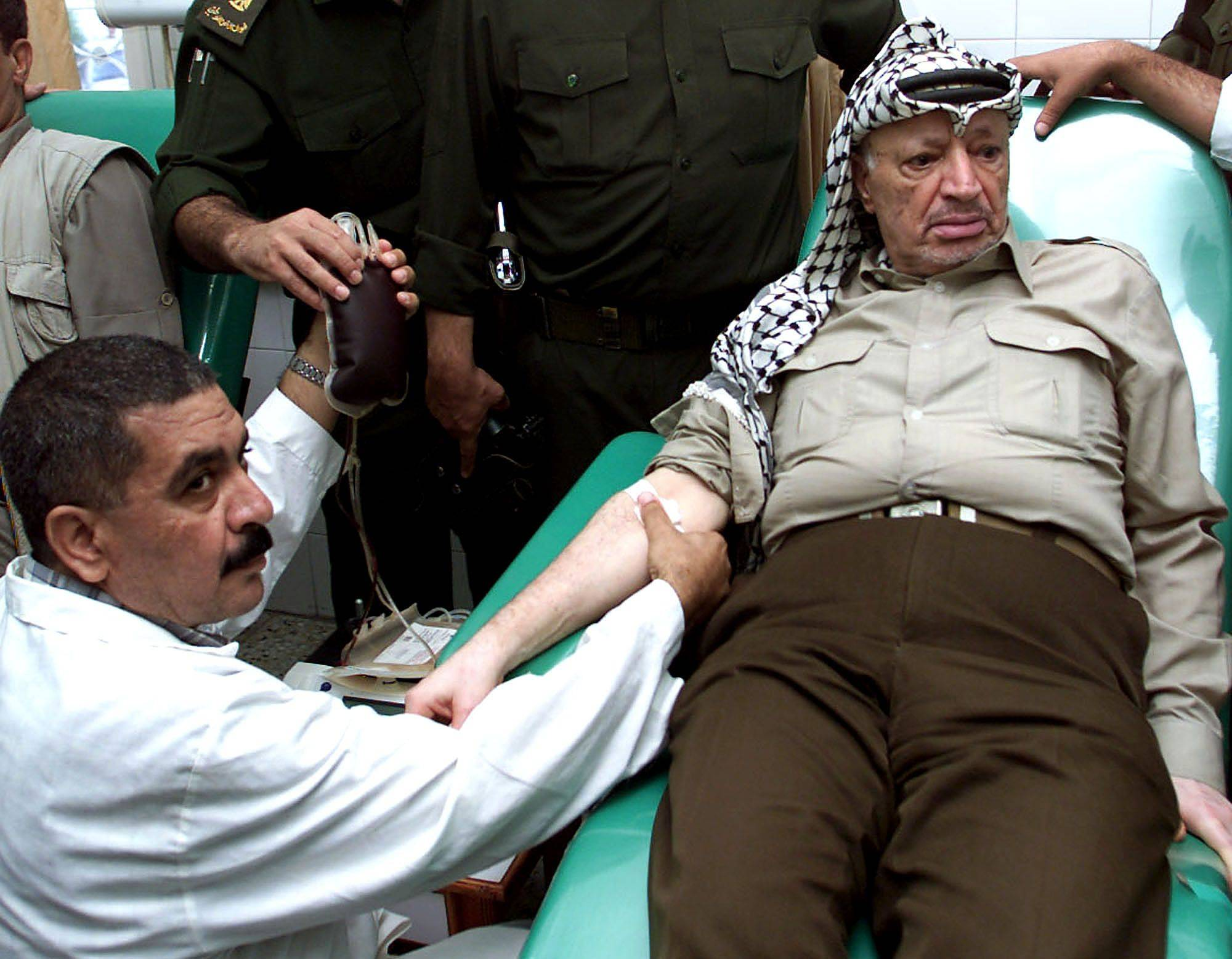 "Palestinian leader Yasser Arafat donates blood at Shifa Hospital in Gaza City, Wednesday, Sept. 12, 2001. Arafat, along with hundreds of Palestinians, participated in a blood drive for the victims of the deadly airline hijackings in the United States which he condemned as a ""horrible attack."""