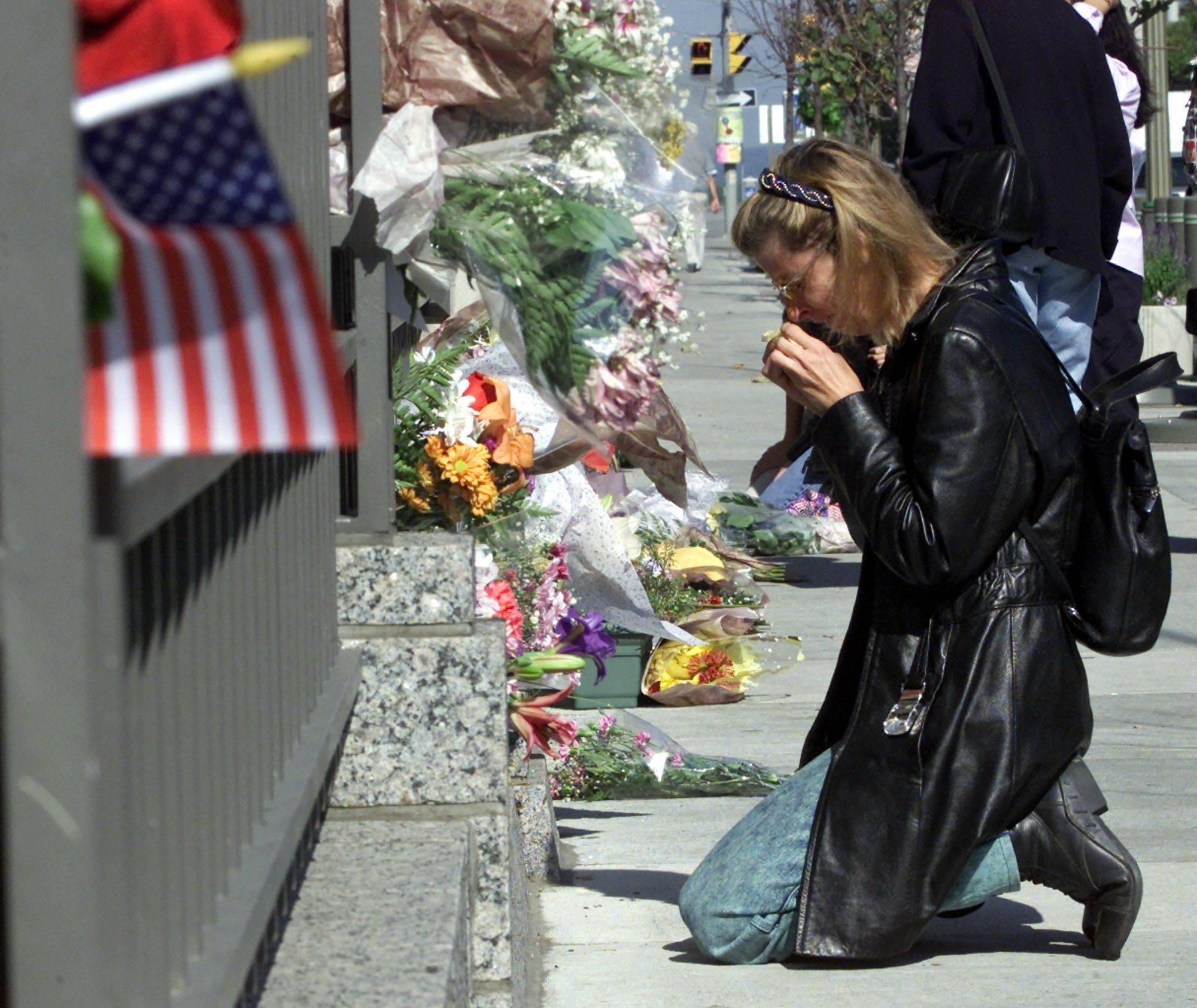 A woman breaks down in tears after leaving a bouquet of flowers outside the U.S. Embassy in Ottawa, Canada, on Sept. 12, 2001.