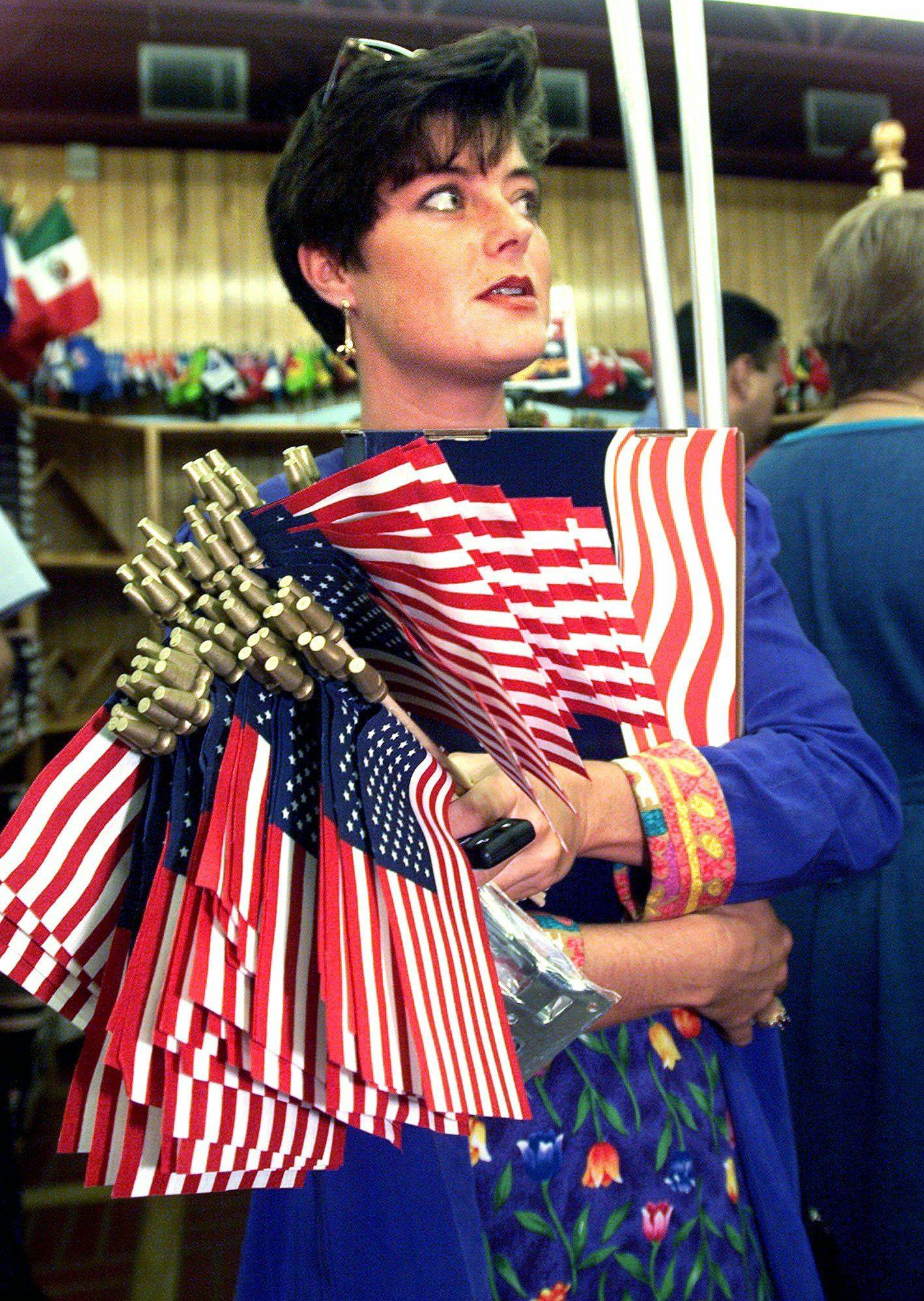 Rachel McMurphy bought dozens of U.S. flags to hand out to her business clients on Sept. 12, 2001, in San Antonio.
