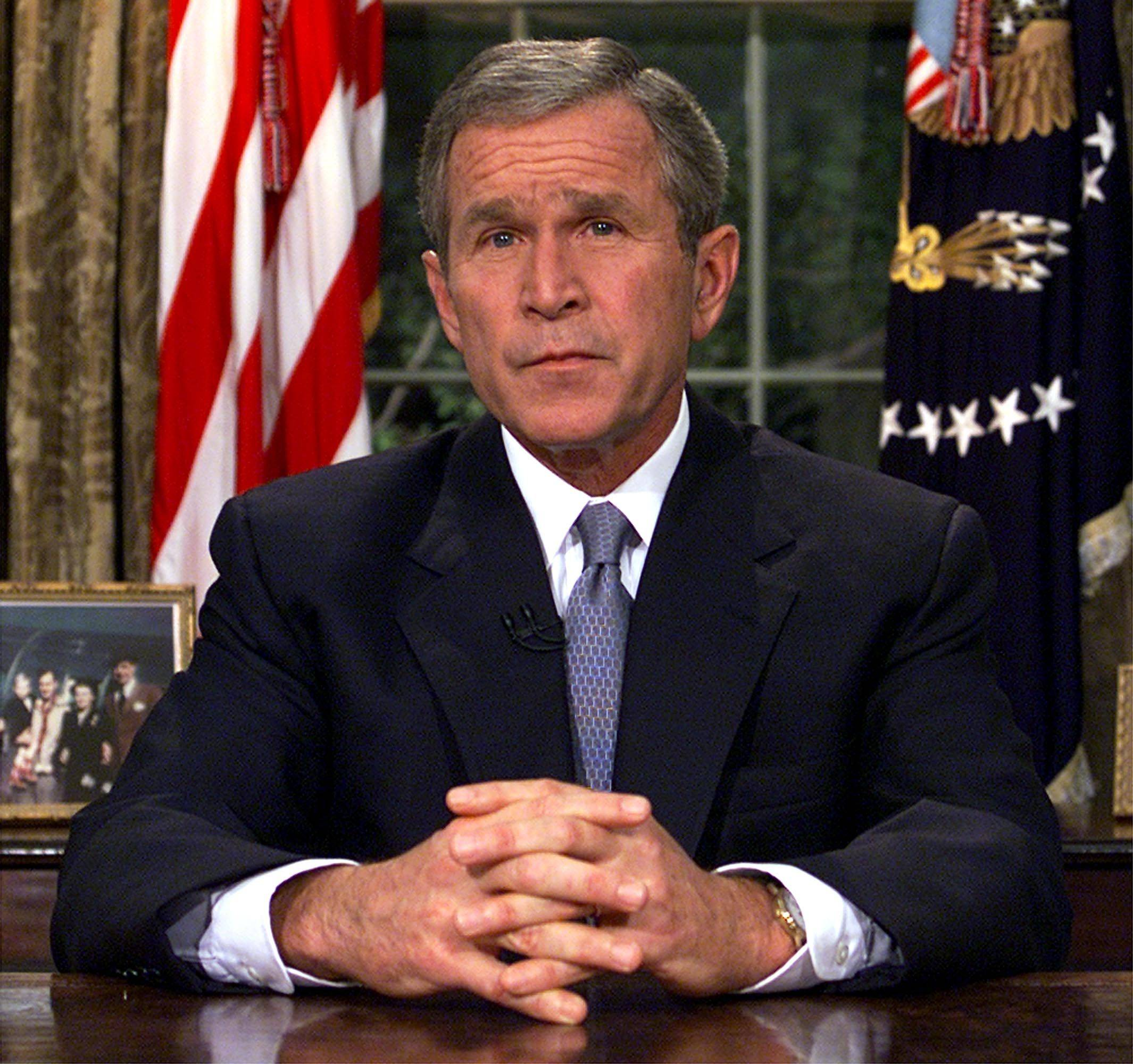 "President George W. Bush addresses the nation on Sept. 11, 2001, from the Oval Office. Bush said, ""Freedom itself has been attacked this morning by a faceless coward."""