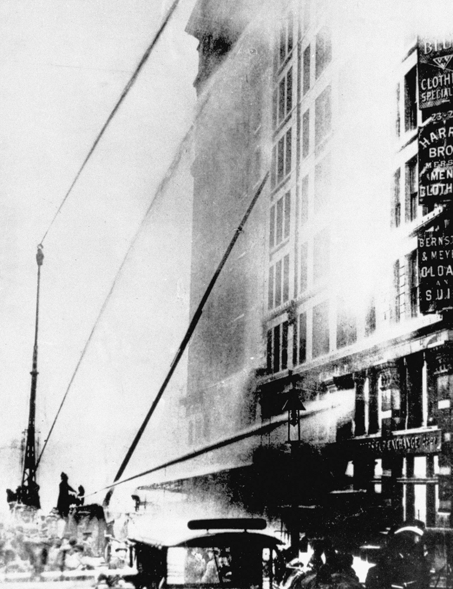 Firefighters work at the scene of the Triangle Shirtwaist Co. fire in the Asch Building on New York's Washington Place in 1911. The fire killed 146 young girls and women and triggered widespread labor reforms.
