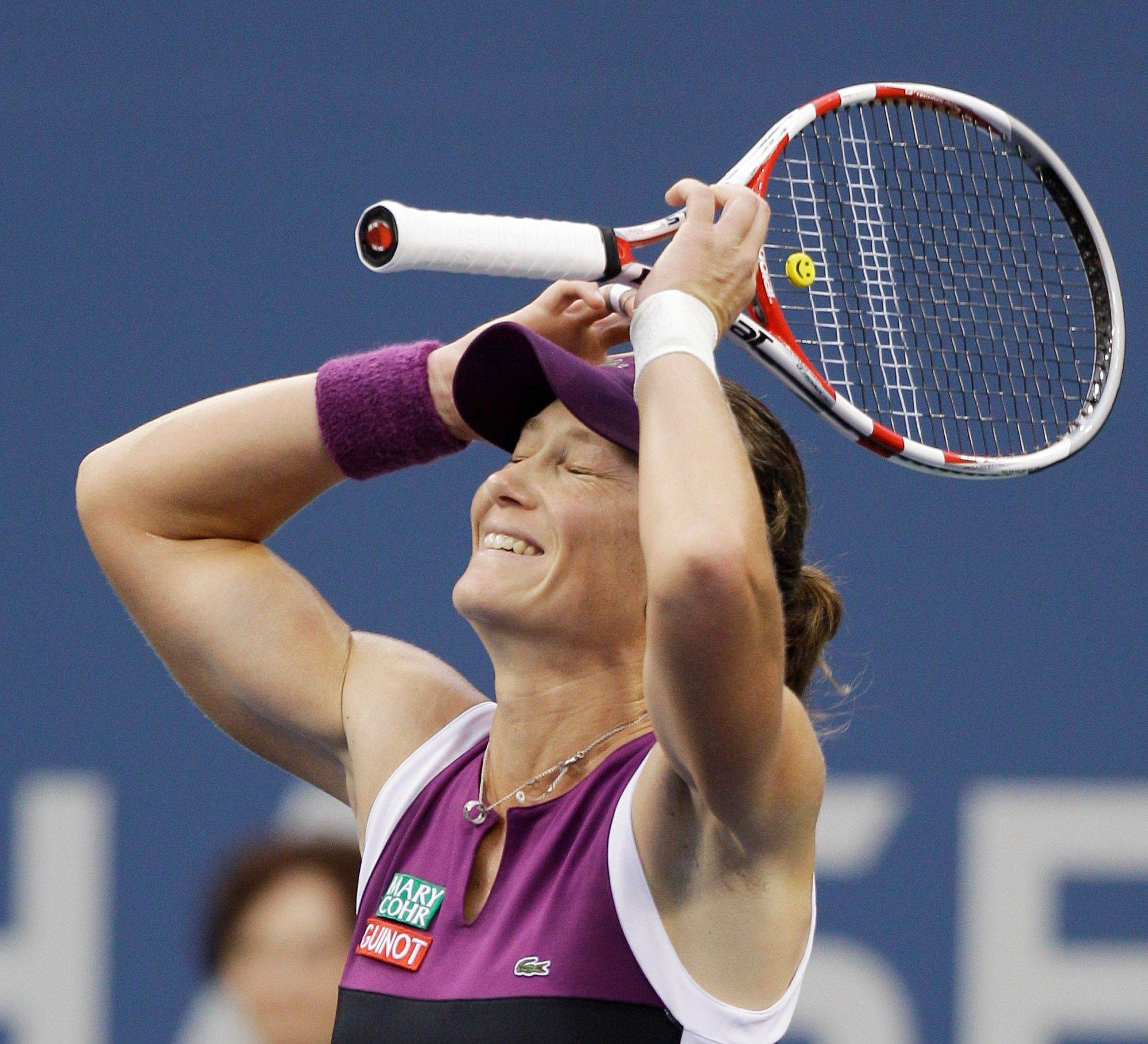 Samantha Stosur reacts after winning the women's championship match against Serena Williams at the U.S. Open on Sunday.