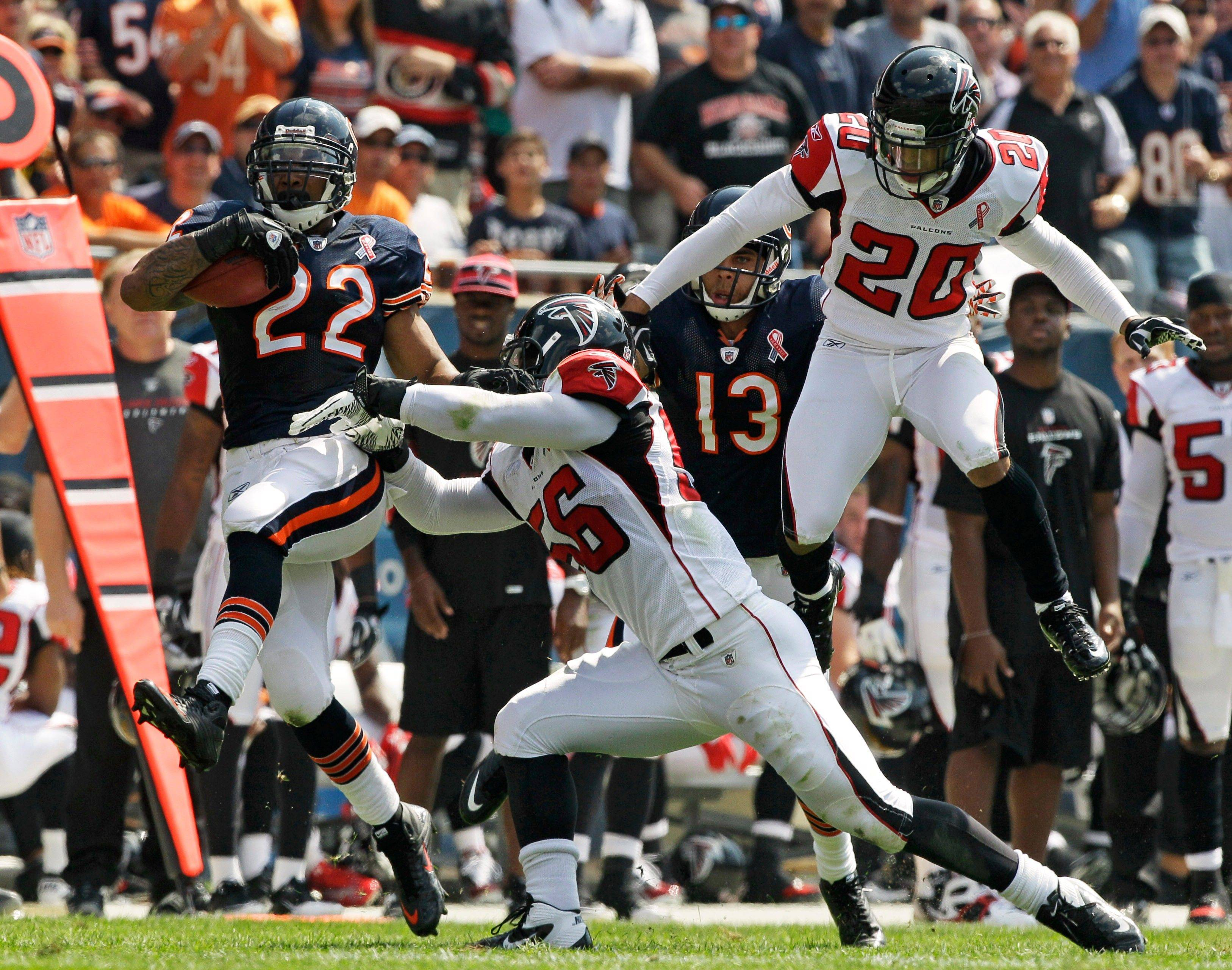 The Bears' Matt Forte shakes off the Falcons' Sean Weatherspoon (56) and Brent Grimes on his way to a 56-yard touchdown on a screen pass in the first half Sunday at Soldier Field.