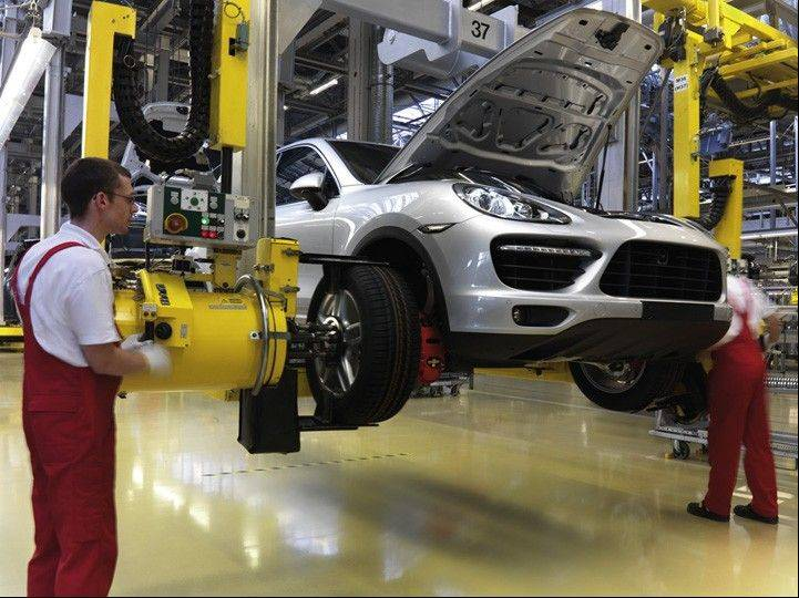 Employees assemble a Porsche Cayenne automobile at the company's factory in Leipzig, Germany, Bloomberg News