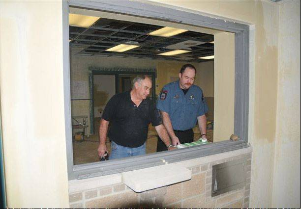Wauconda Fire District Battalion Chief Bob Rucker, left, looks over the construction of the new dispatch center with dispatcher Jim Pepper.