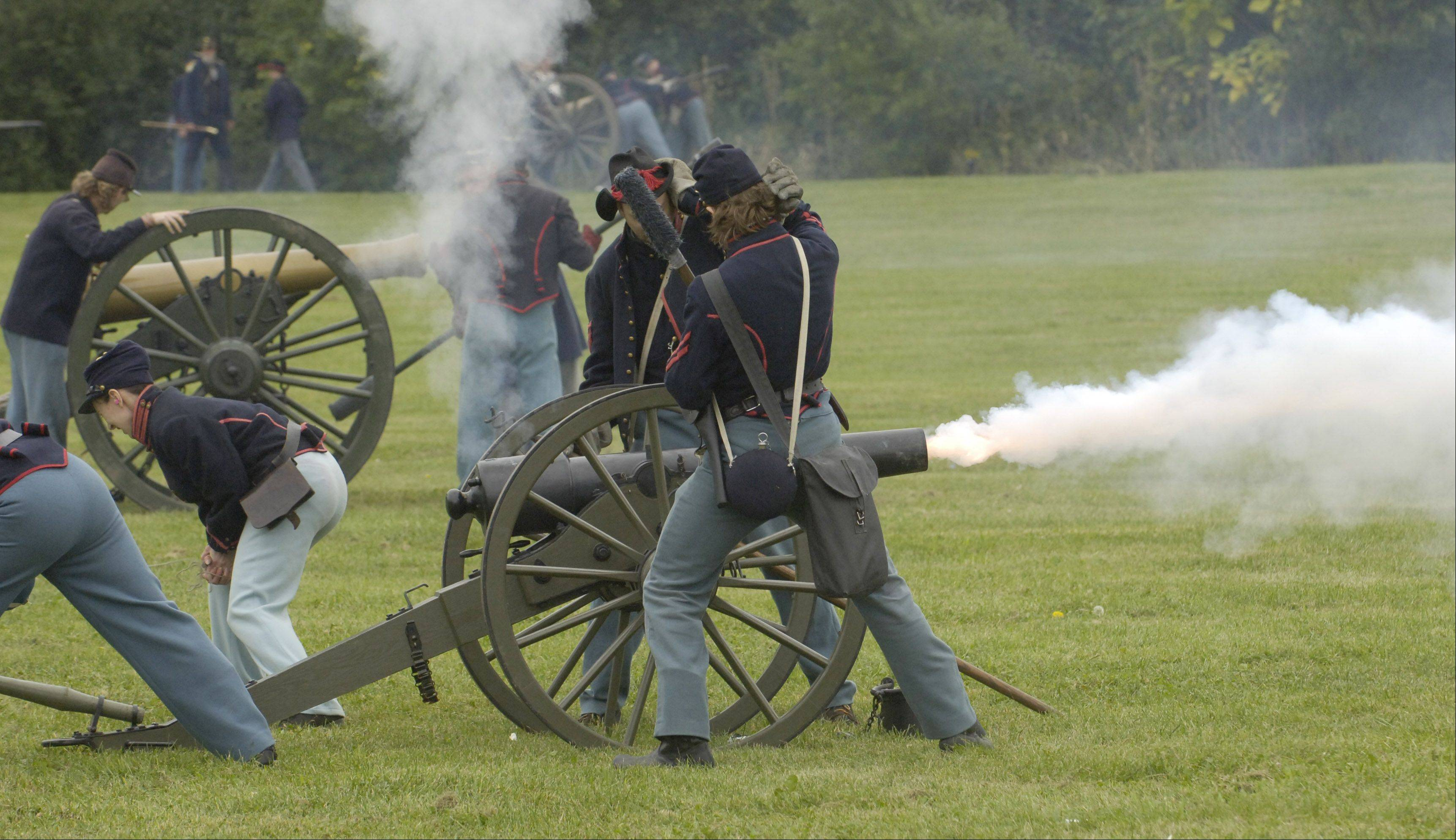 Union troops fire their artillery pieces during Civil War Days at Lehmann Mansion in Lake Villa.