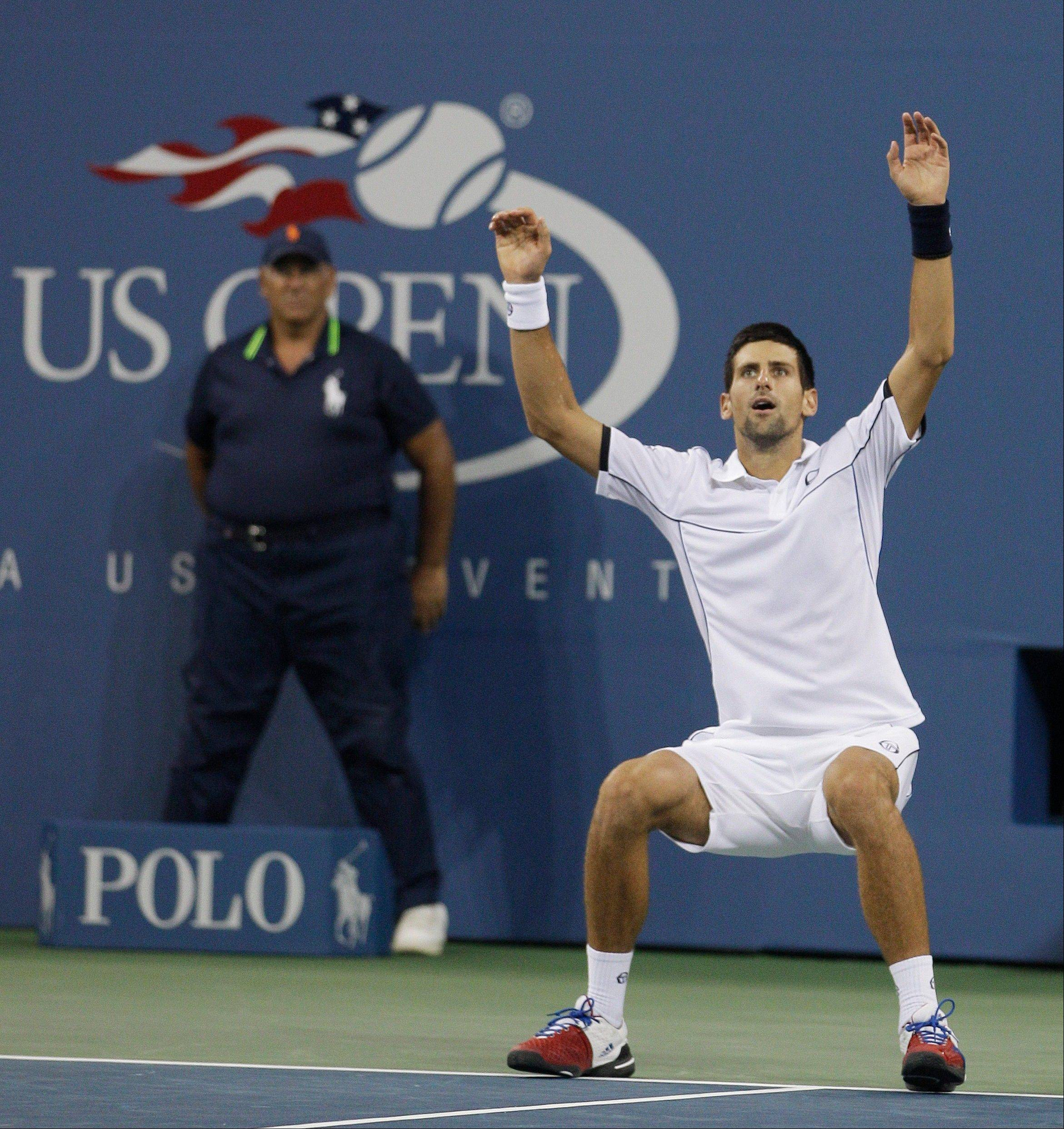 Novak Djokovic reacts Monday after winning the U.S. Open.
