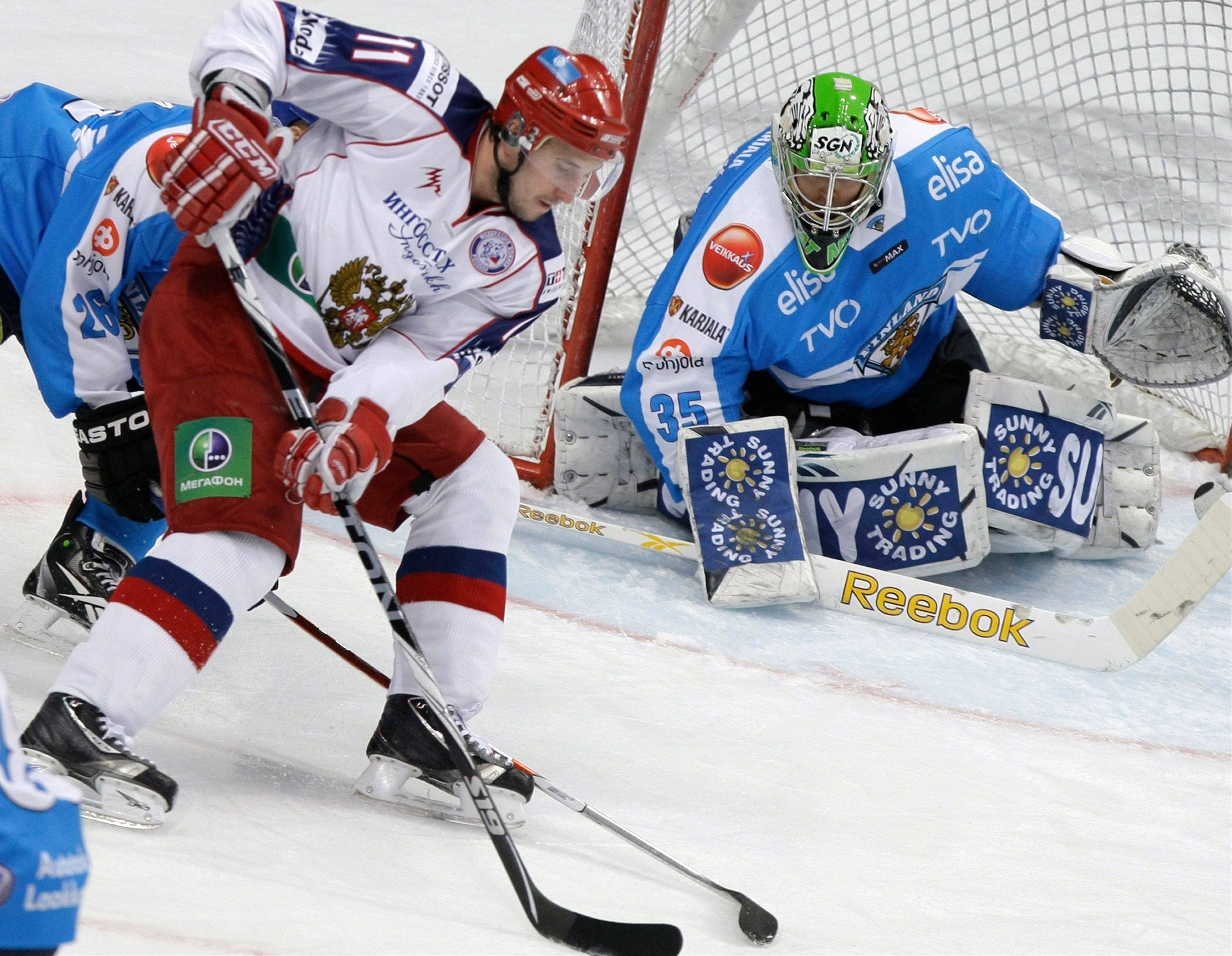 Russia's Alexander Galimov, shown here on left trying to score against Finland's Liro Tarkki during their Channel One Cup ice hockey match in Moscow last year, died Monday of injuries suffered in the Russian jet crash that killed his teammates last Wednesday.