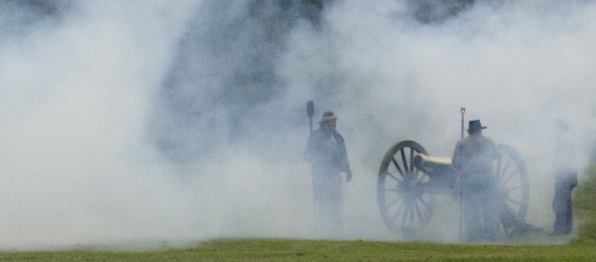 Smoke obscures a confederate artillery unit during Civil War Days at Lehmann Mansion in Lake Villa.