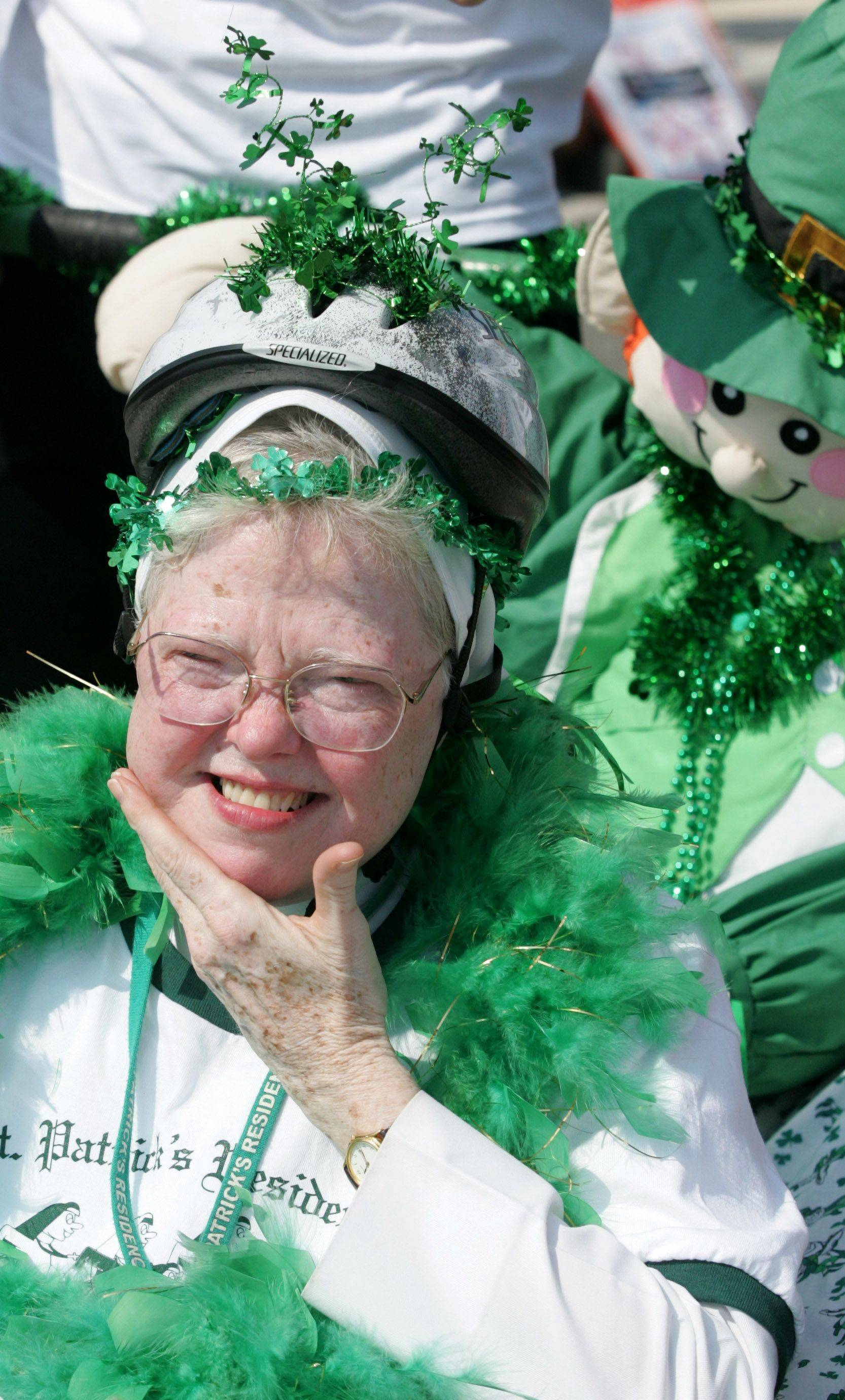 Sister Raphael Schmitz of the St. Patrick's Nuns on the Run team wins the bed races at the Last Fling celebration in downtown Naperville.