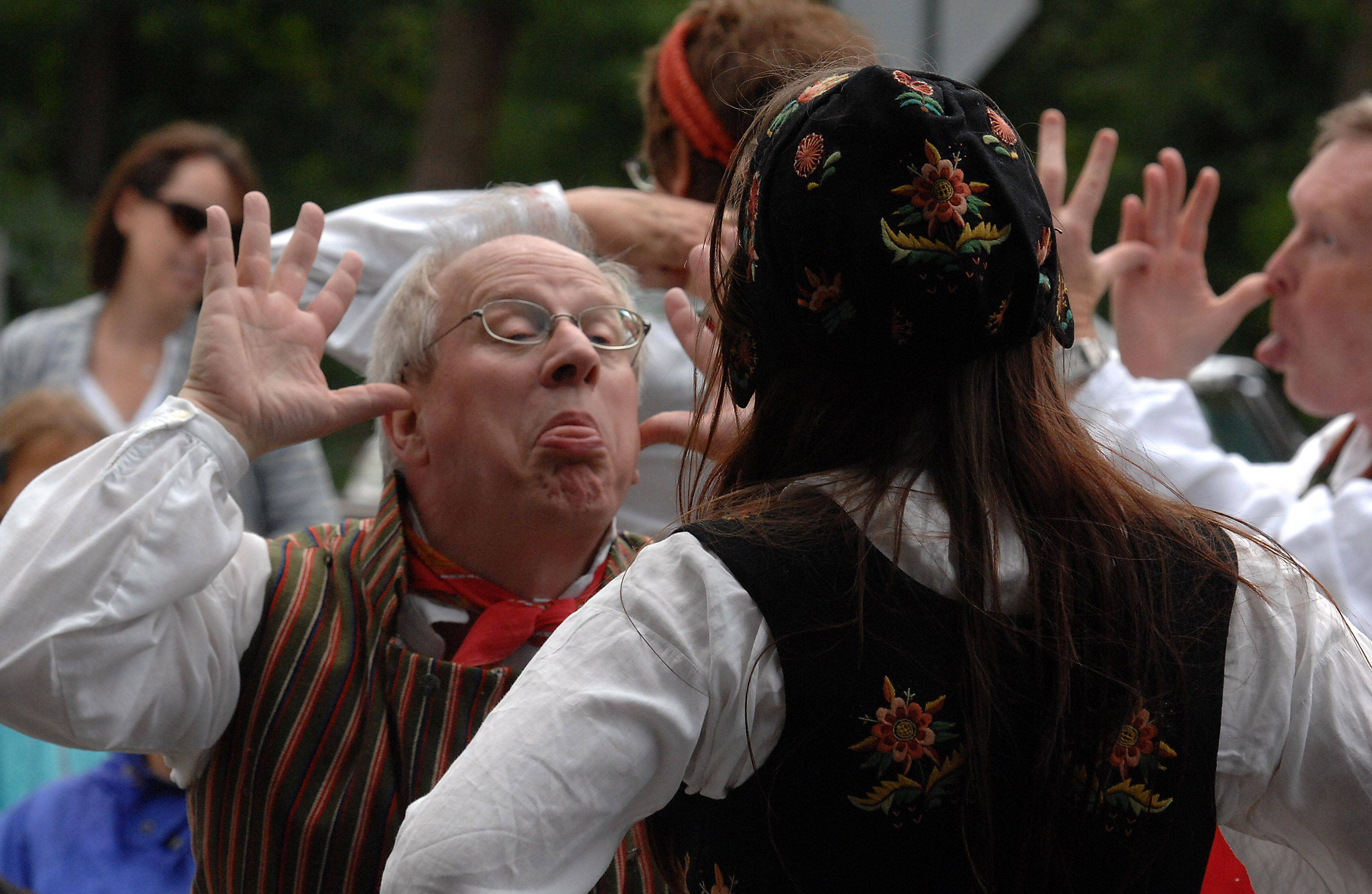 Bruce Carlson of North Brook does the Norwegian Snus Polka with his dance partner during the Long Grove World Tour International on Monday.