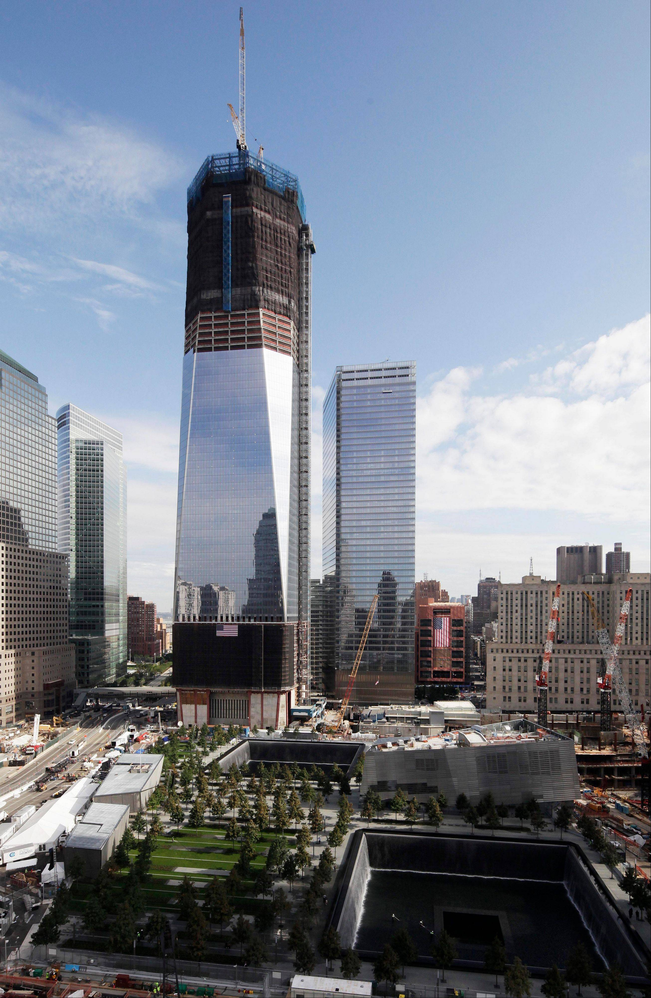 One World Trade Center in New York overlooks the National September 11 Memorial, which opens to the public under tight security Monday.