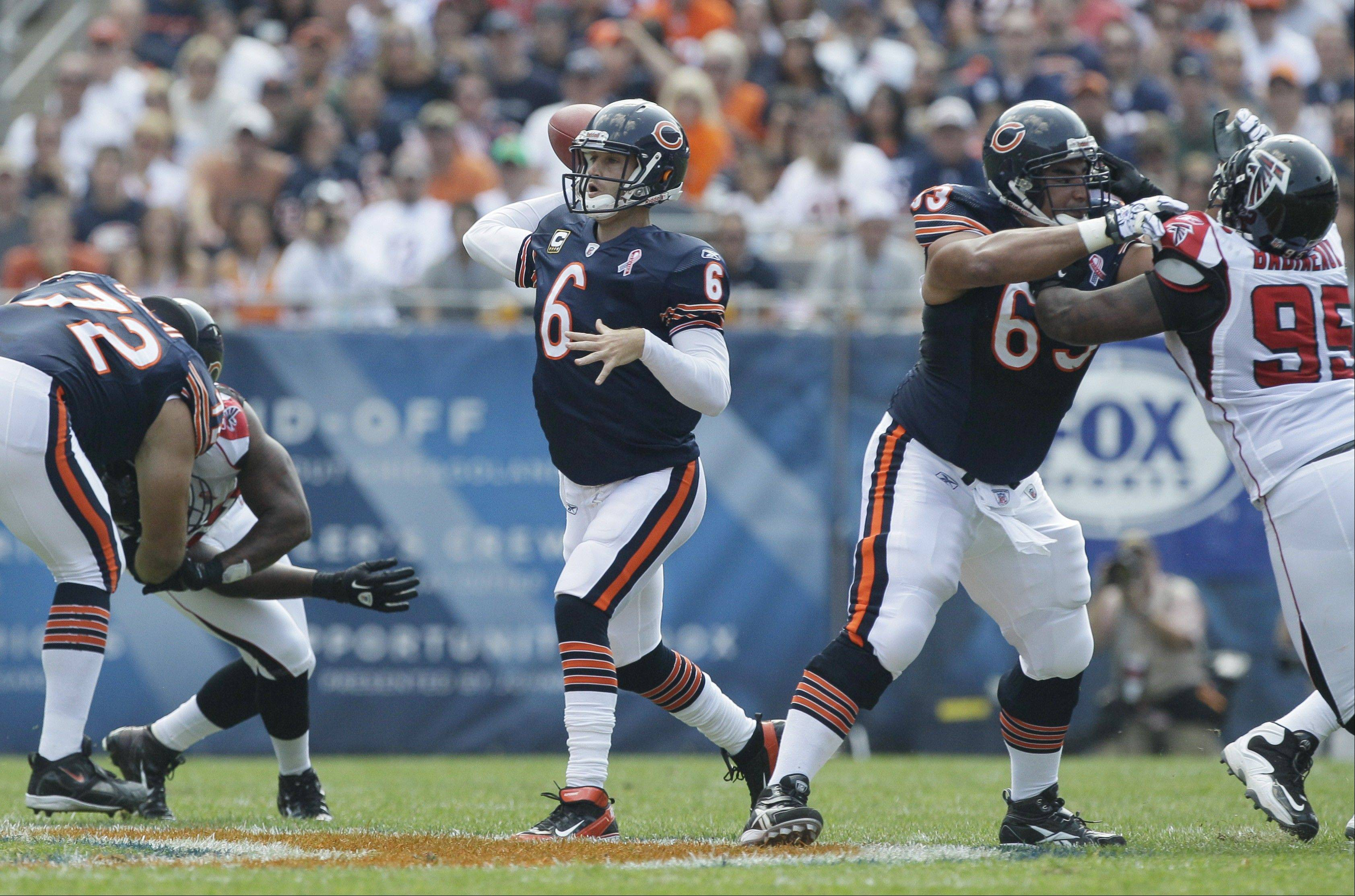 Bears quarterback Jay Cutler looks to pass in the first half Sunday against the Falcons.
