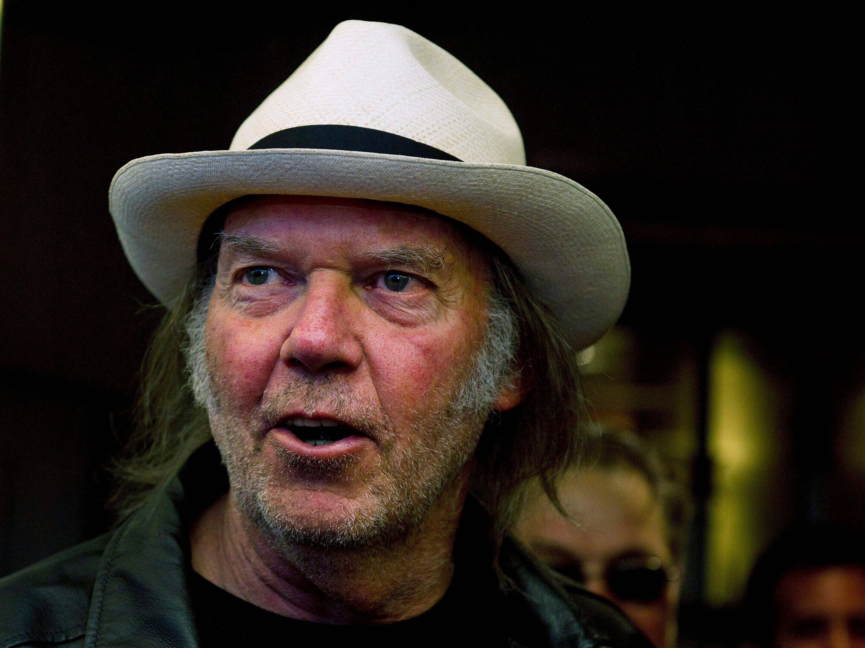 "Musician Neil Young arrives for the film ""Neil Young Journeys"" at the Toronto International Film Festival."