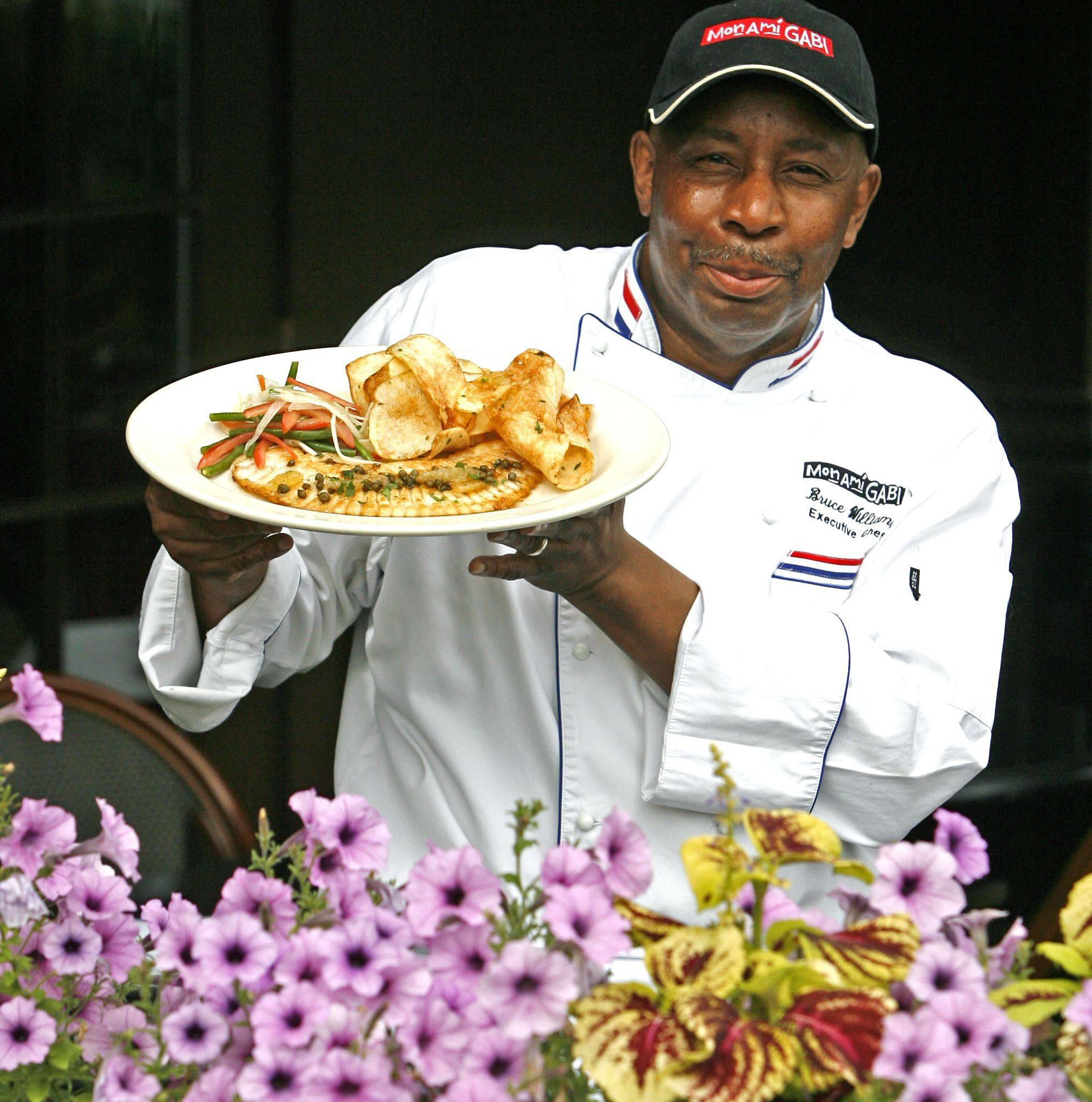Chef Bruce Williams has been in the restaurant business for 25 years, most recently serving French food at Mon Ami in Oak Brook where he makes a popular dish of Skate Wing with garlic potato chips and summer salad.