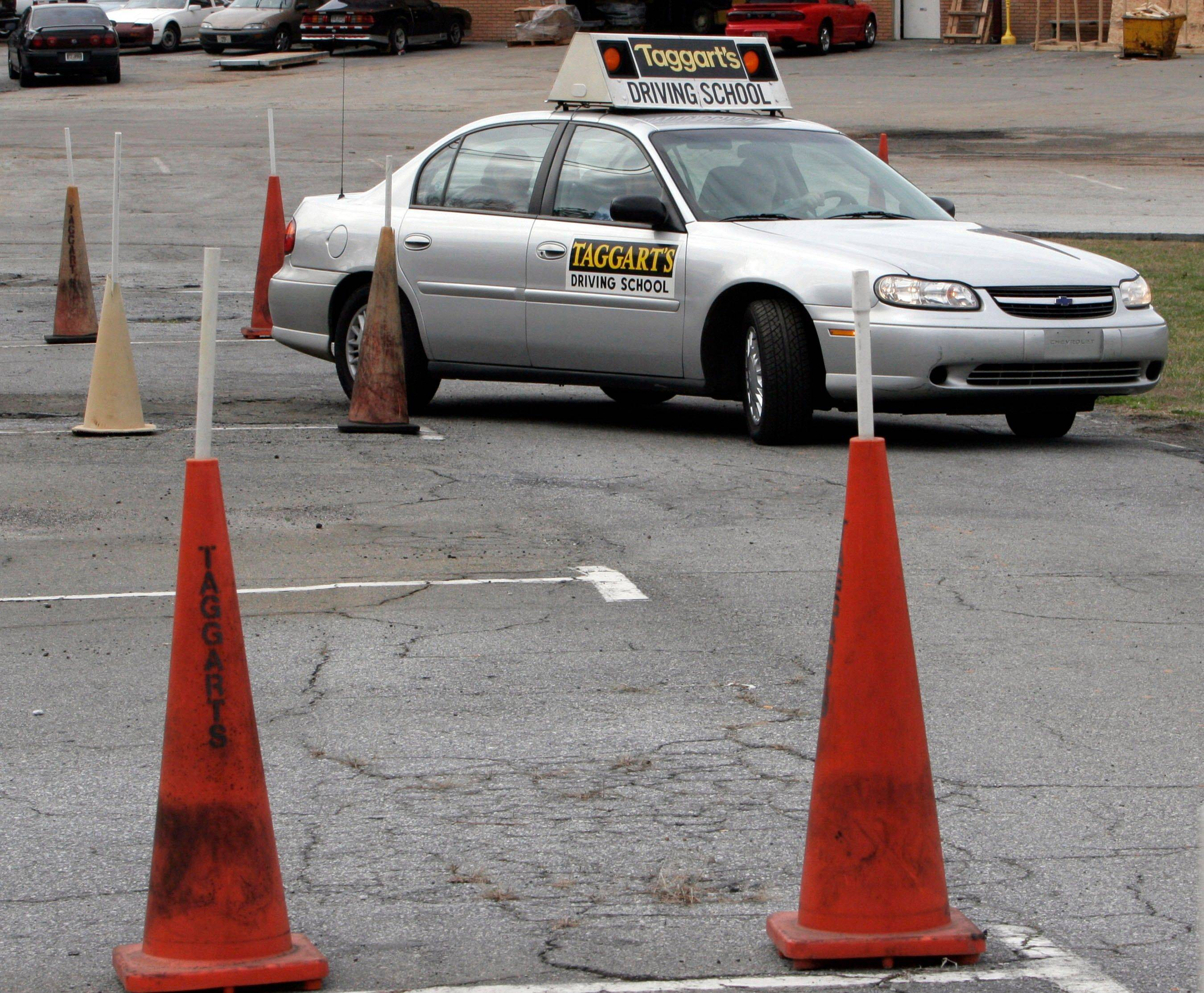 A student goes through parking cones at a driving school course in Tucker, Ga. Strong driver's license laws have led to fewer fatal crashes among 16-year-olds but with a disturbing side effect — more fatal accidents among 18-year-olds, a nationwide study found.
