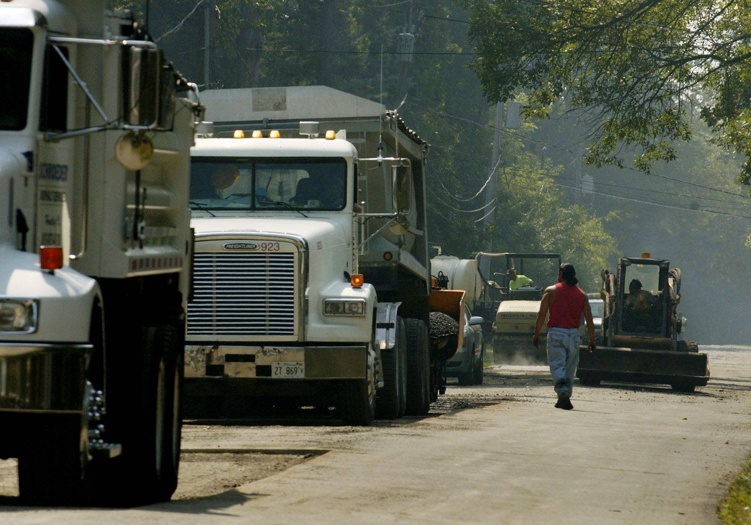 Workers patch Geraldine Lane in Wauconda Township on Tuesday. Some residents recently complained about the road's condition near Port Barrington.