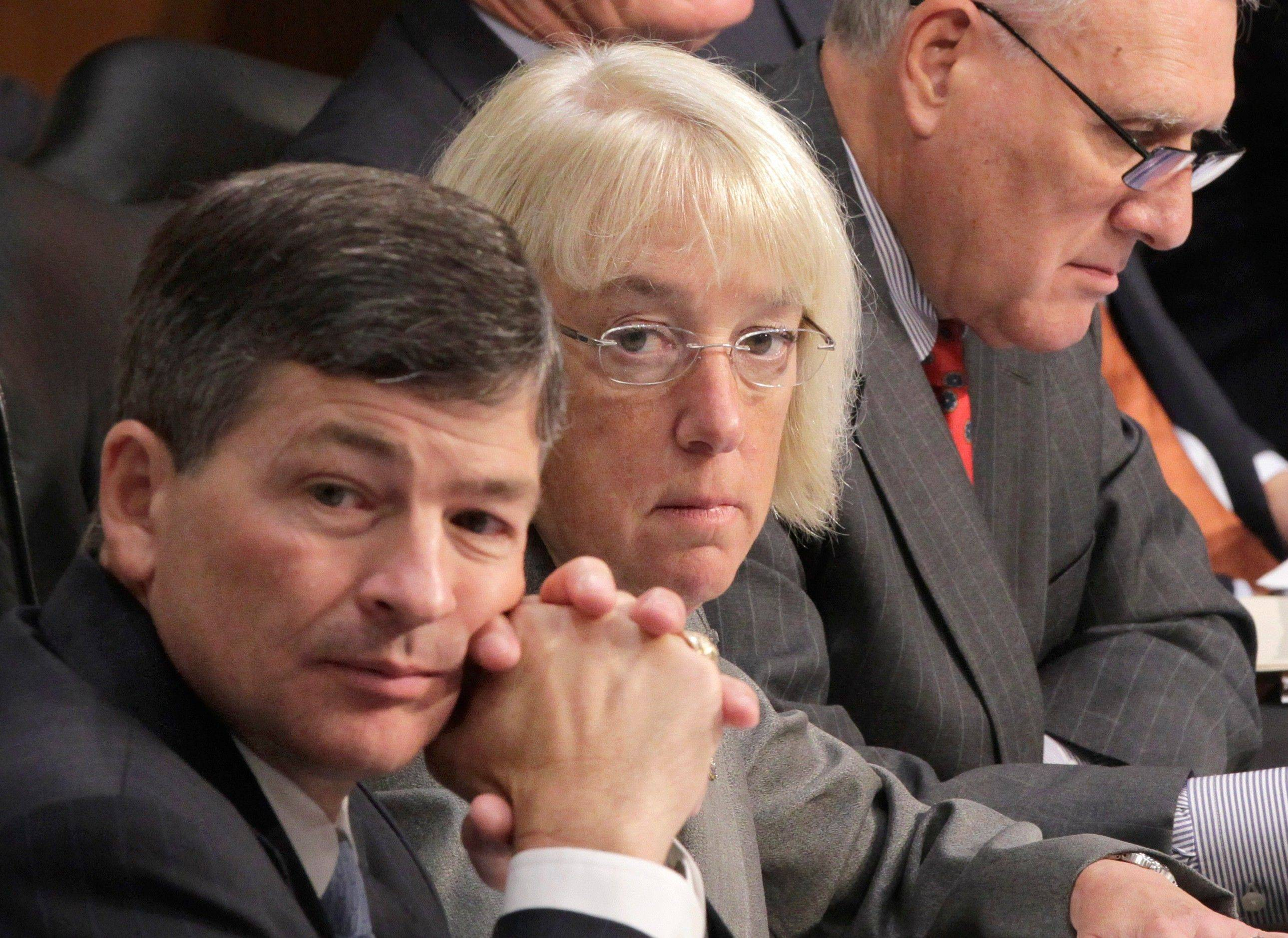 Joint Select Committee on Deficit Reduction Co-Chairs Rep. Jeb Hensarling, left, and Sen. Patty Murray, center, listen as Congressional Budget Office Director Douglas Elmendorf testifies before the committee on Capitol Hill Tuesday.