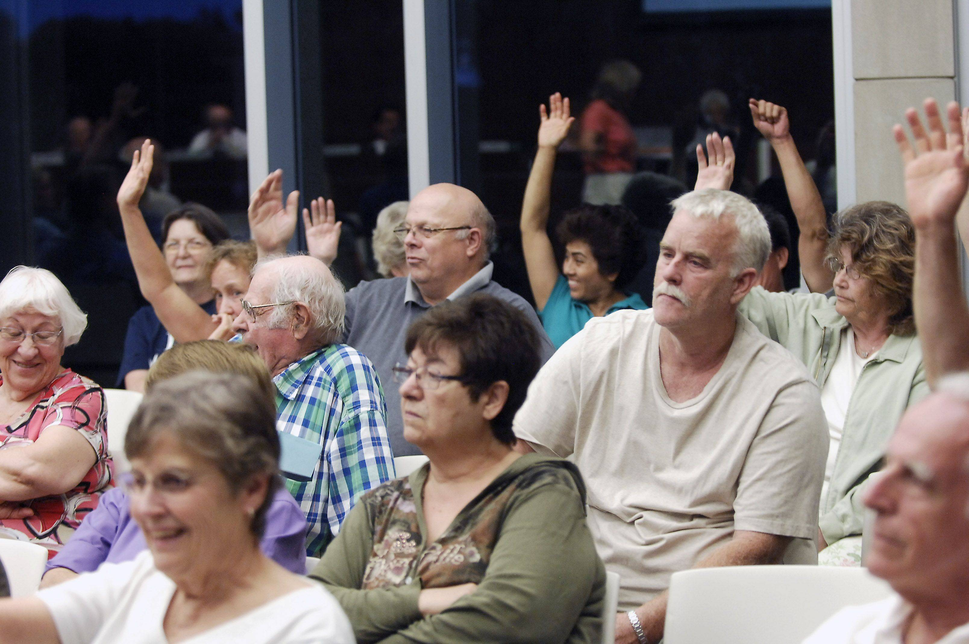 The majority of residents at the village board meeting Monday night in Wheeling raise their hands when asked if they live in the Valley Stream neighborhood.