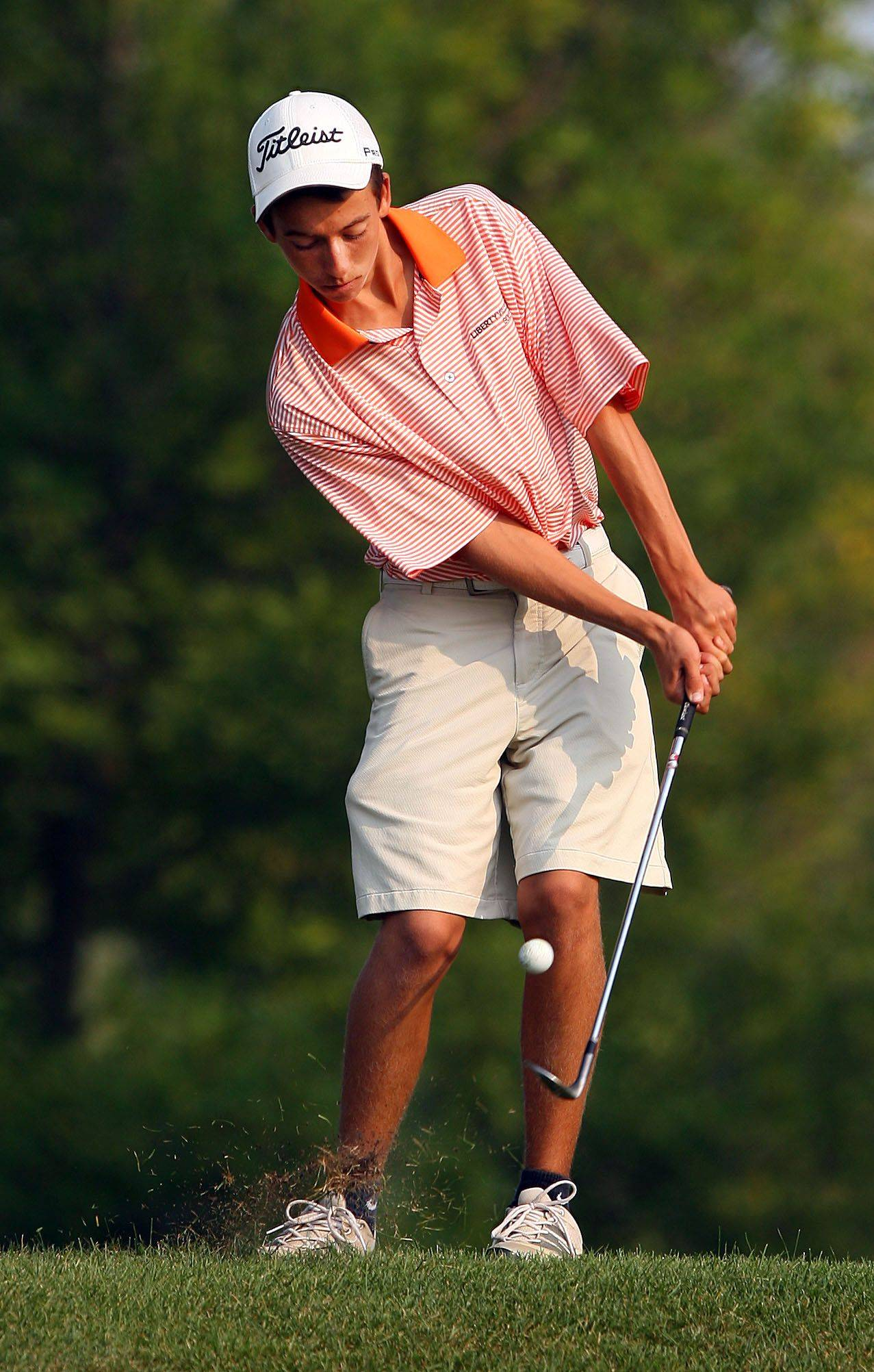 Libertyville's John Cordan chips on the second hole during boys golf action Tuesday at Arboretum in Buffalo Grove.